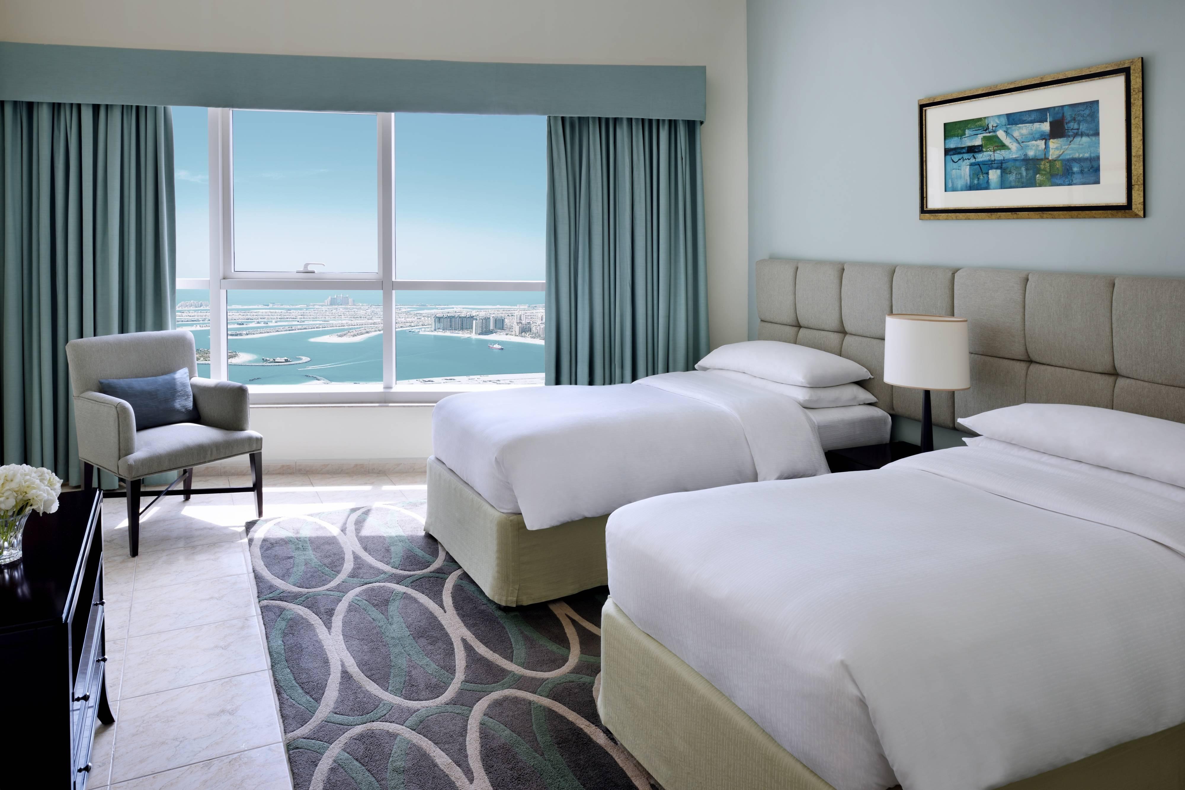 جناح مطل على البحر بغرفتي نوم - غرفة نوم بسريرين صغيرين