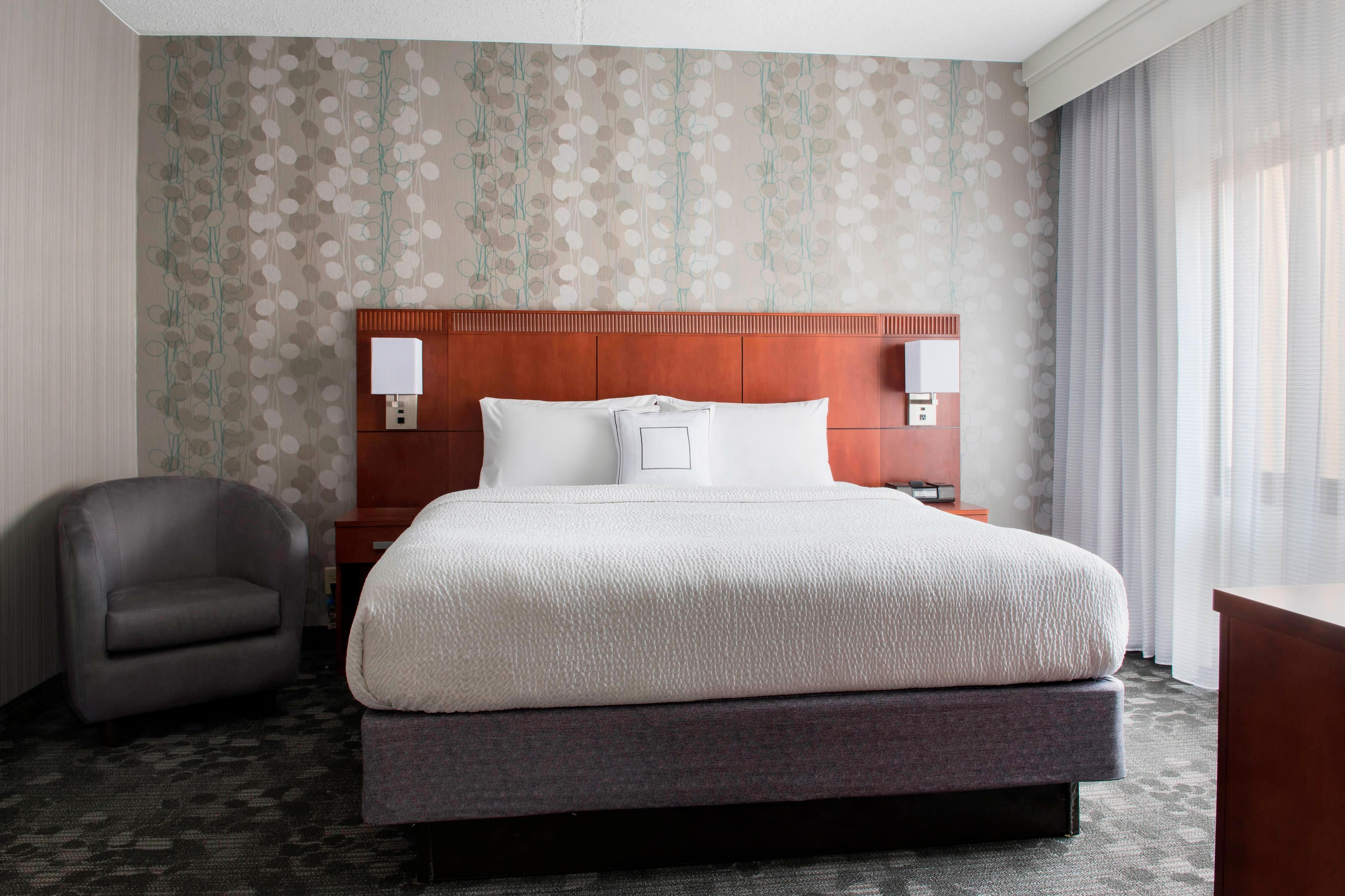 Suite de un dormitorio con cama tamaño King - Dormitorio