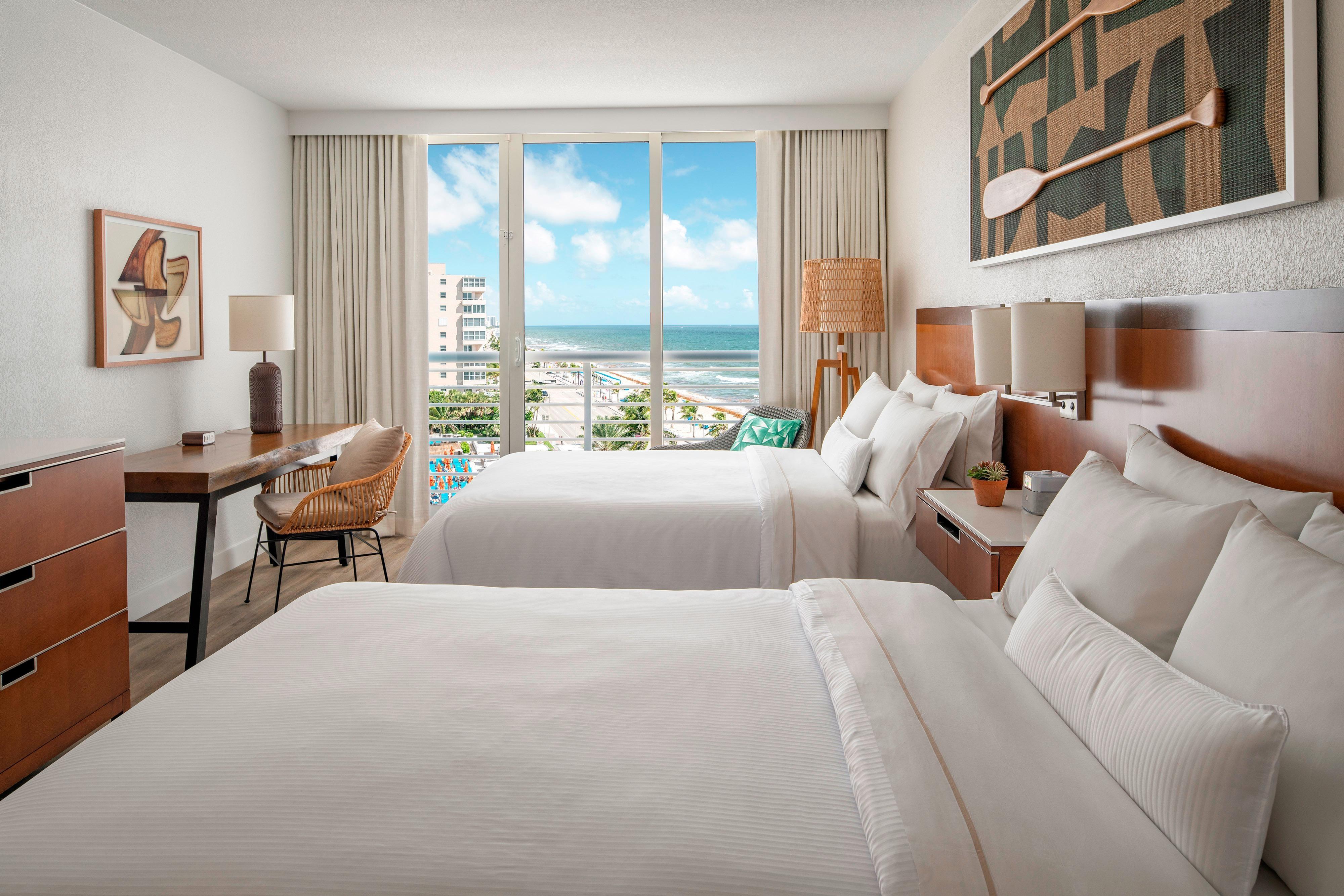 Gästezimmer mit zwei Doppelbetten – Teil-Meerblick