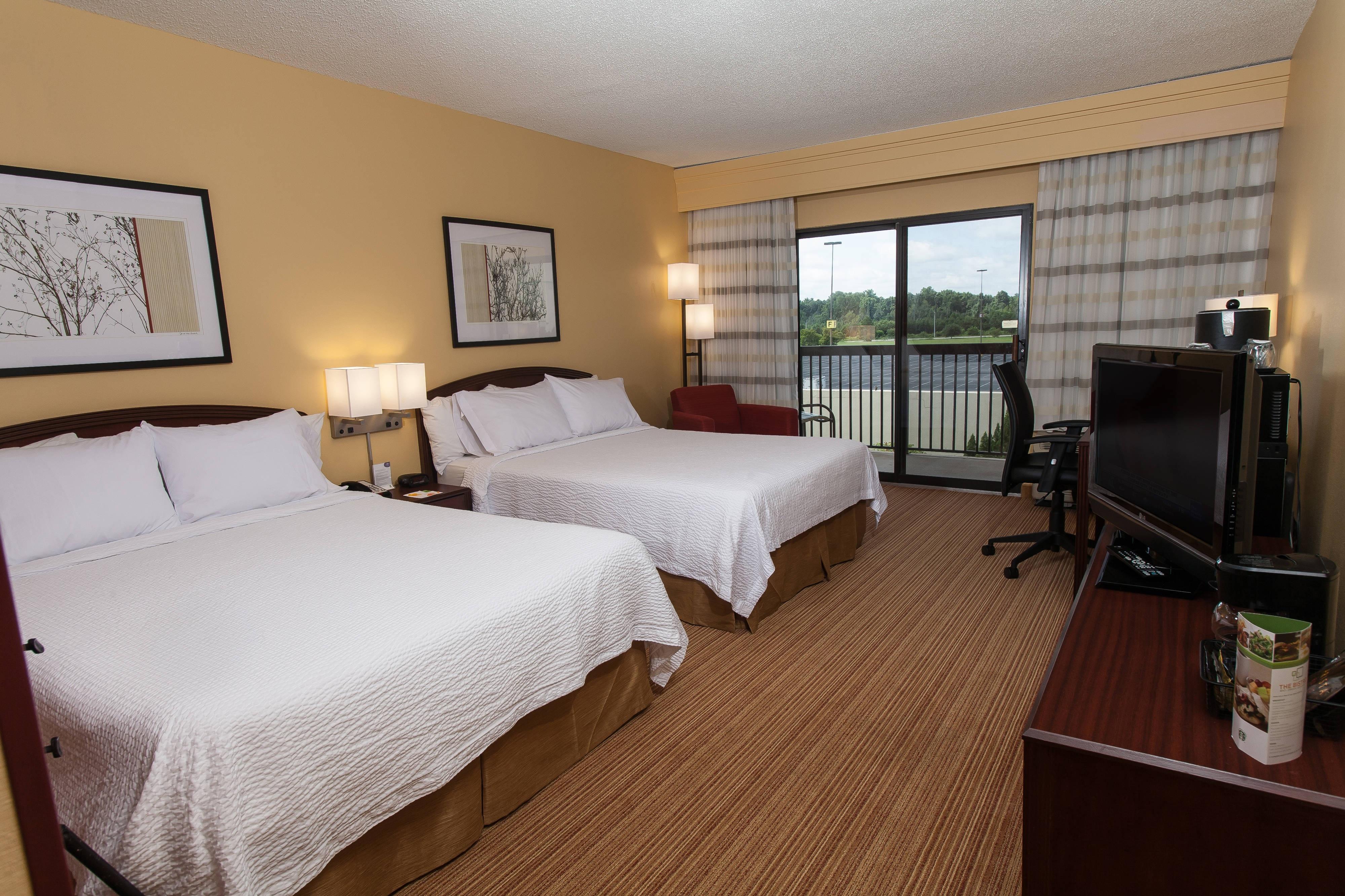Gästezimmer mit zwei Queensize-Betten