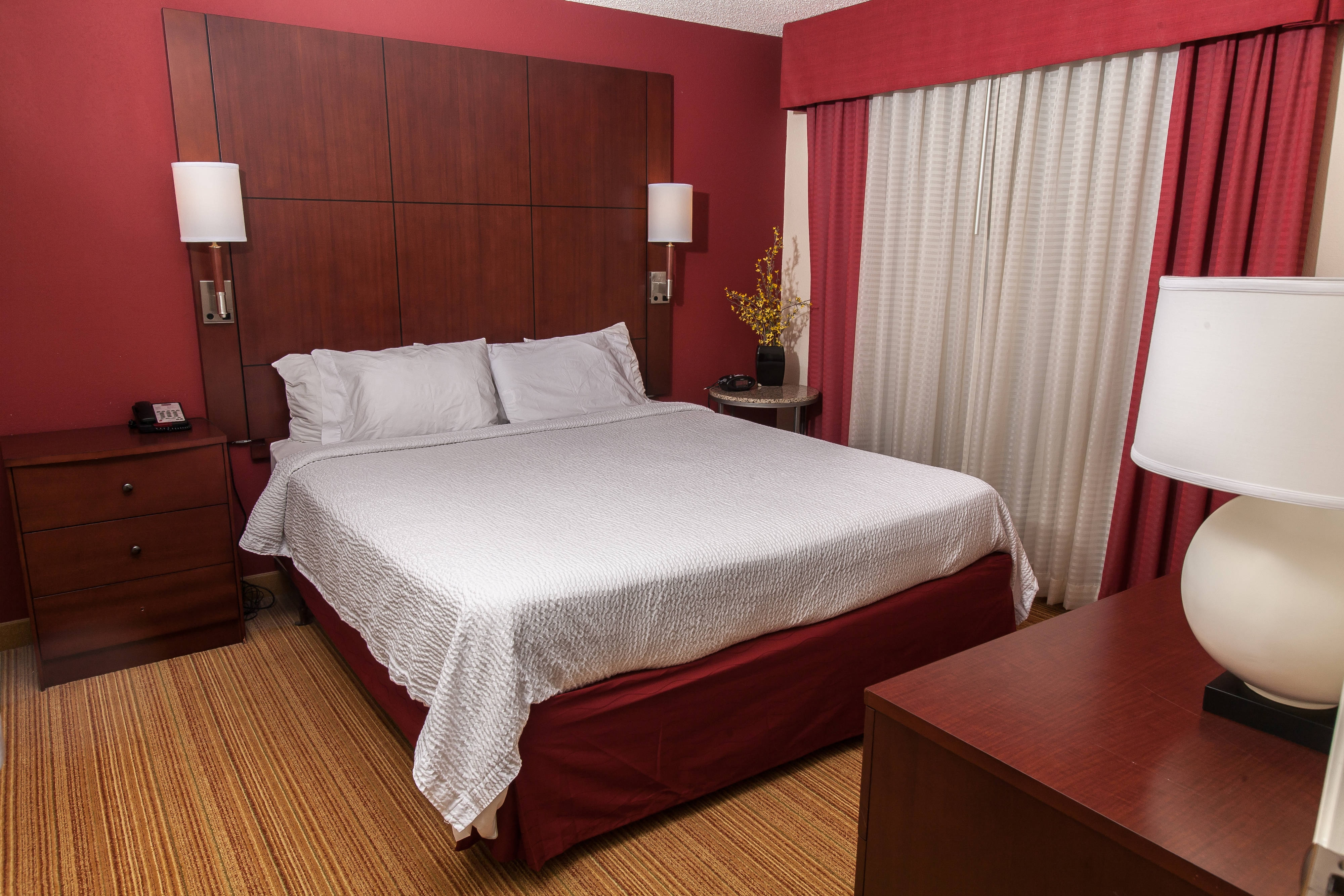 The One-Bedroom King Suite was designed with guests comfort in mind with a private bedroom with a king-size bed and private bathroom.  This suite offers two bedside tables with drawers, a dresser with