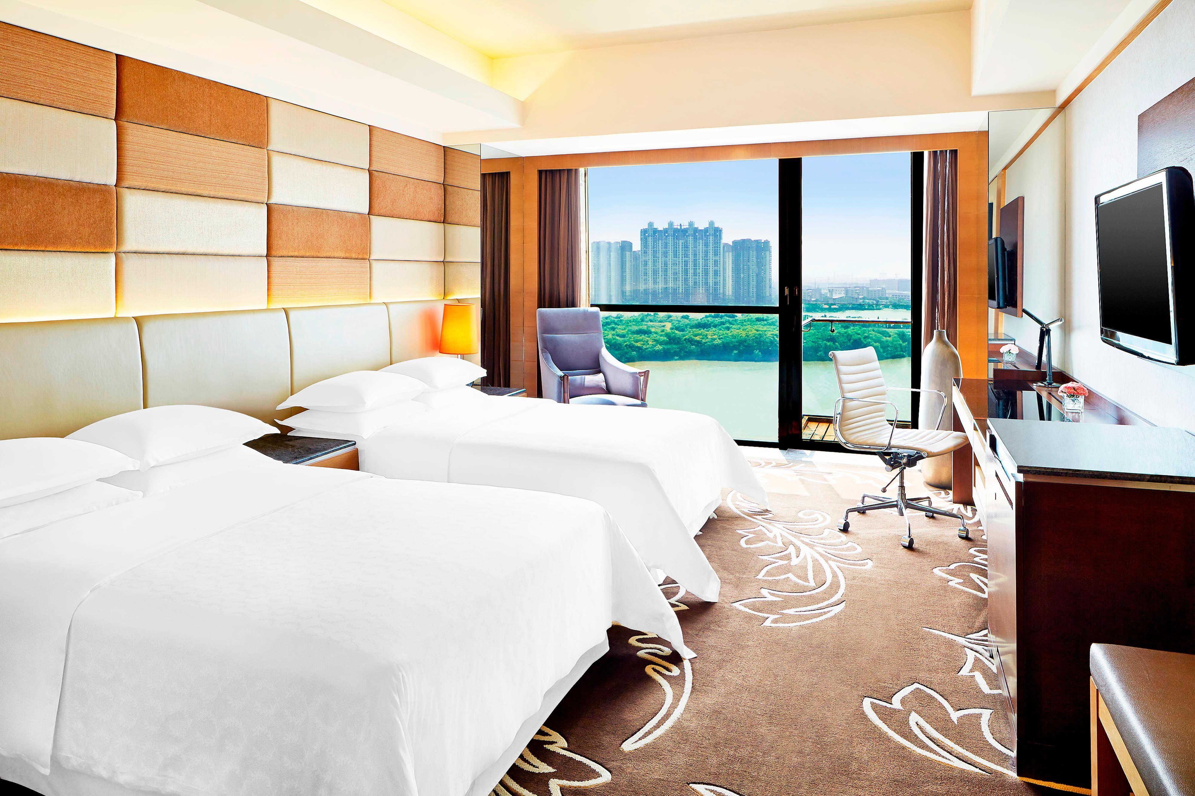 SSH Deluxe Zimmer mit zwei Einzelbetten und Blick auf den Fluss