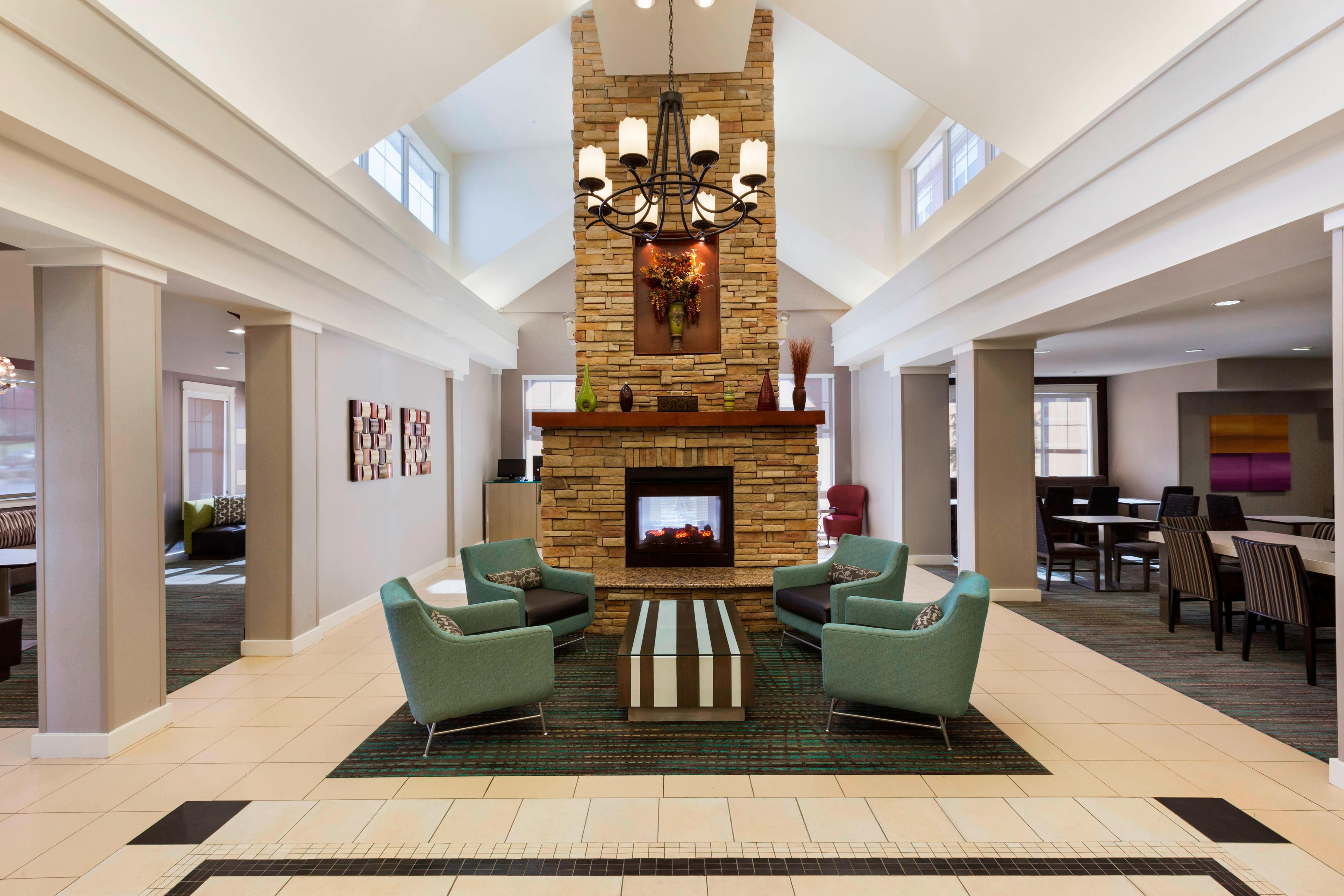 Lobby with sitting area and fireplace