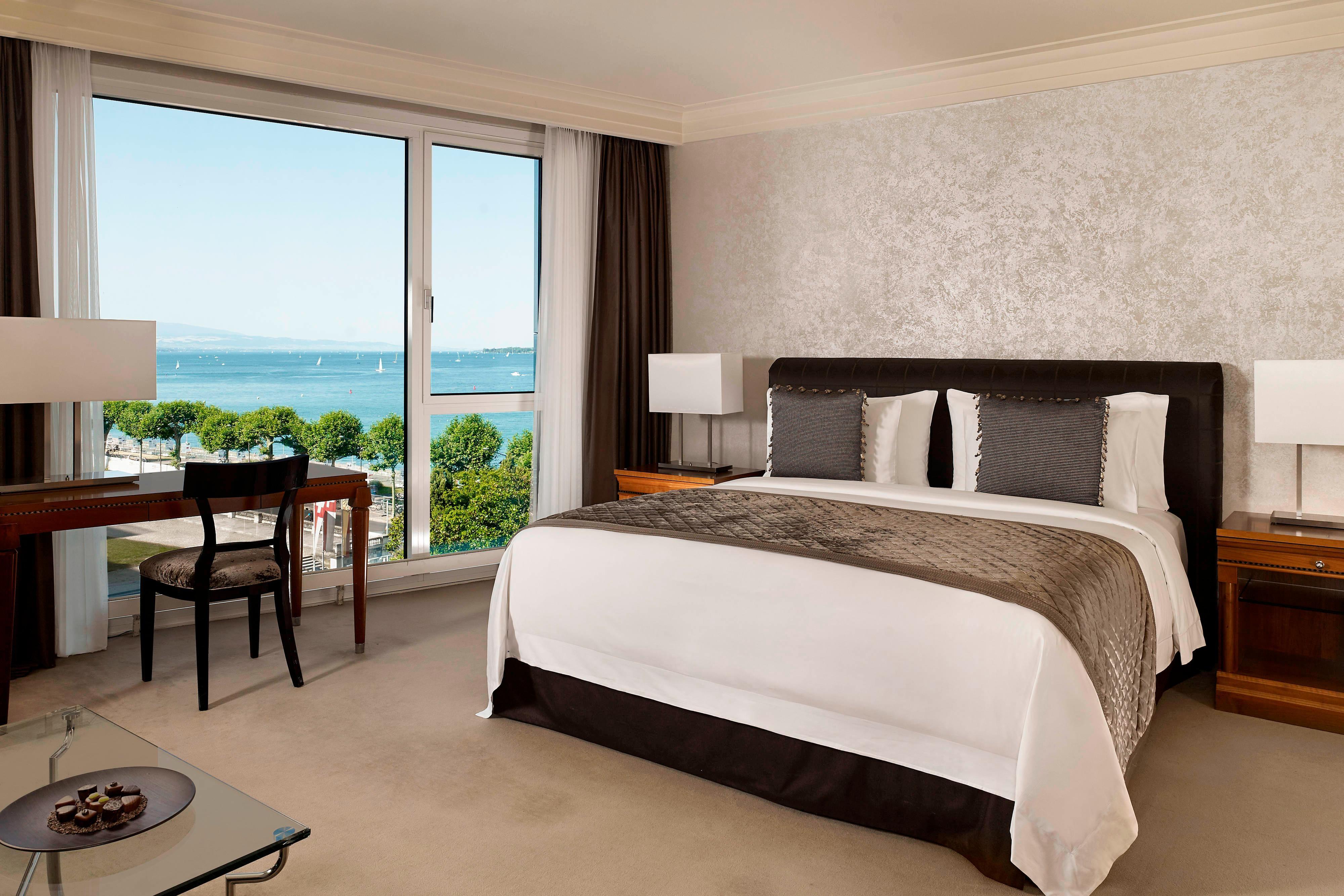 Grand Deluxe Room Bedroom & Living Area