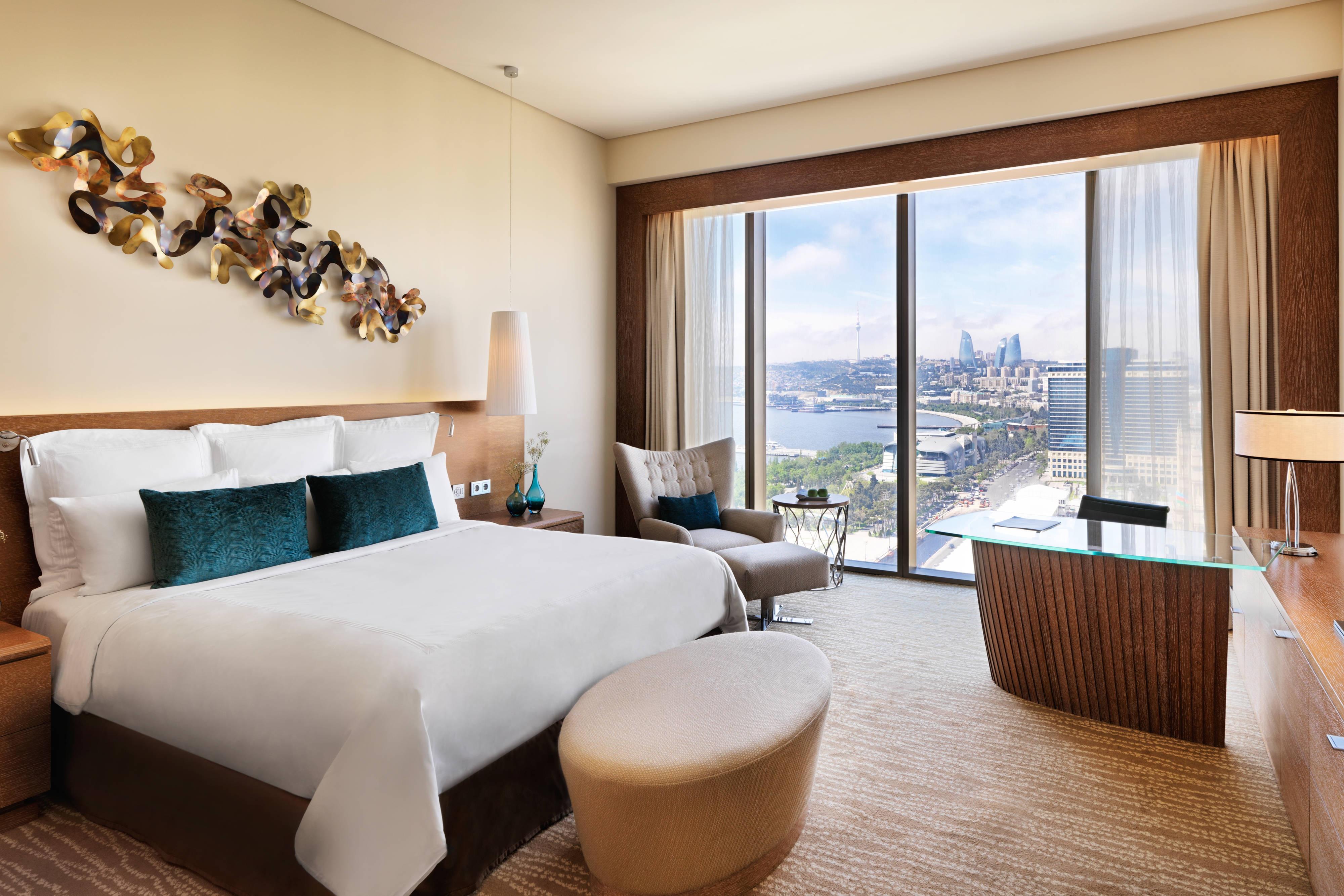 Deluxe Zimmer mit Kingsize-Bett und Meerblick