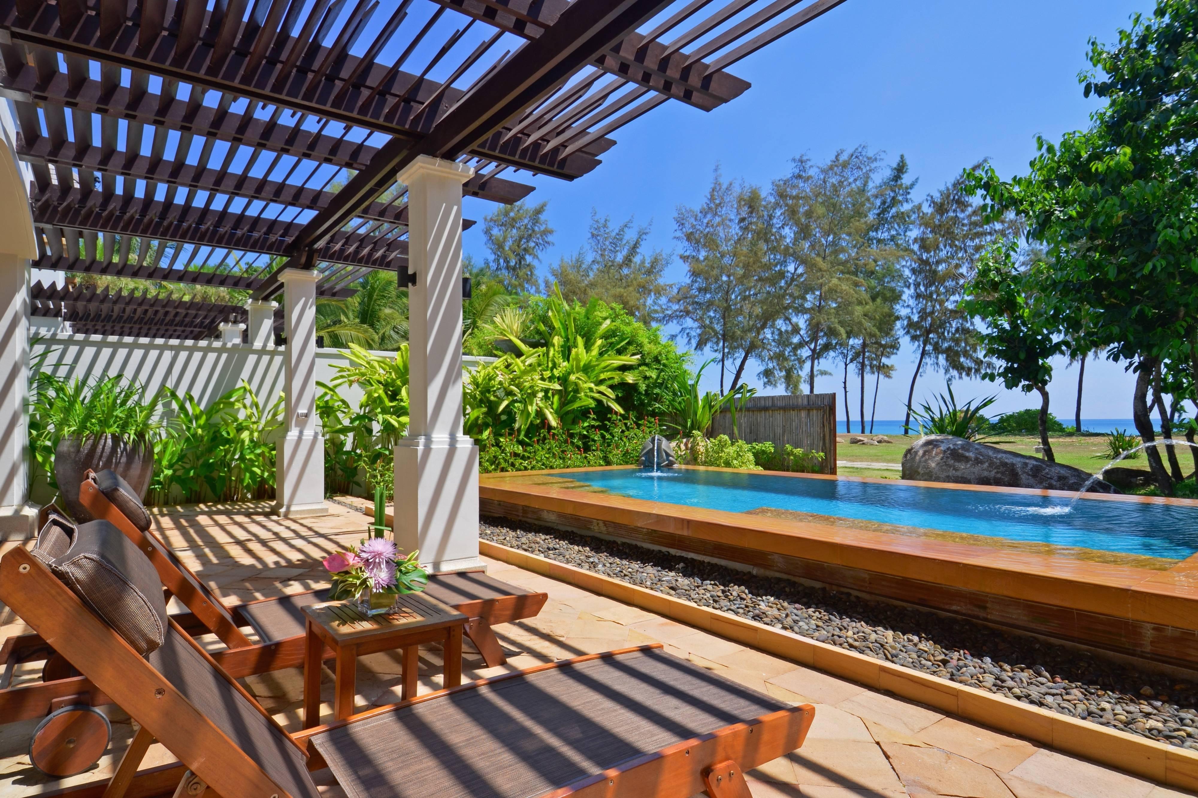 Suite de un dormitorio con piscina frente al mar