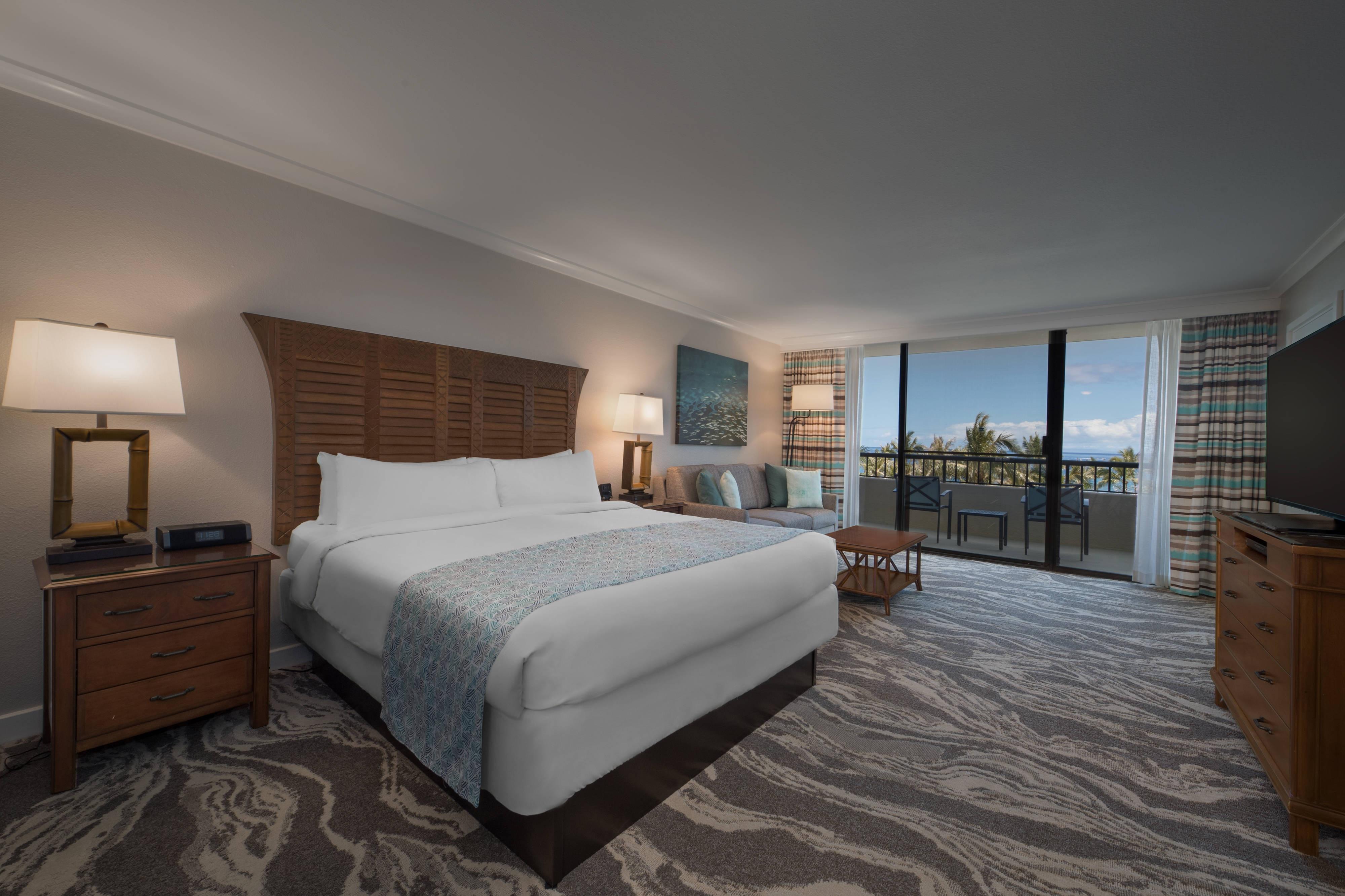 Chambre avec lit king size et vue mer