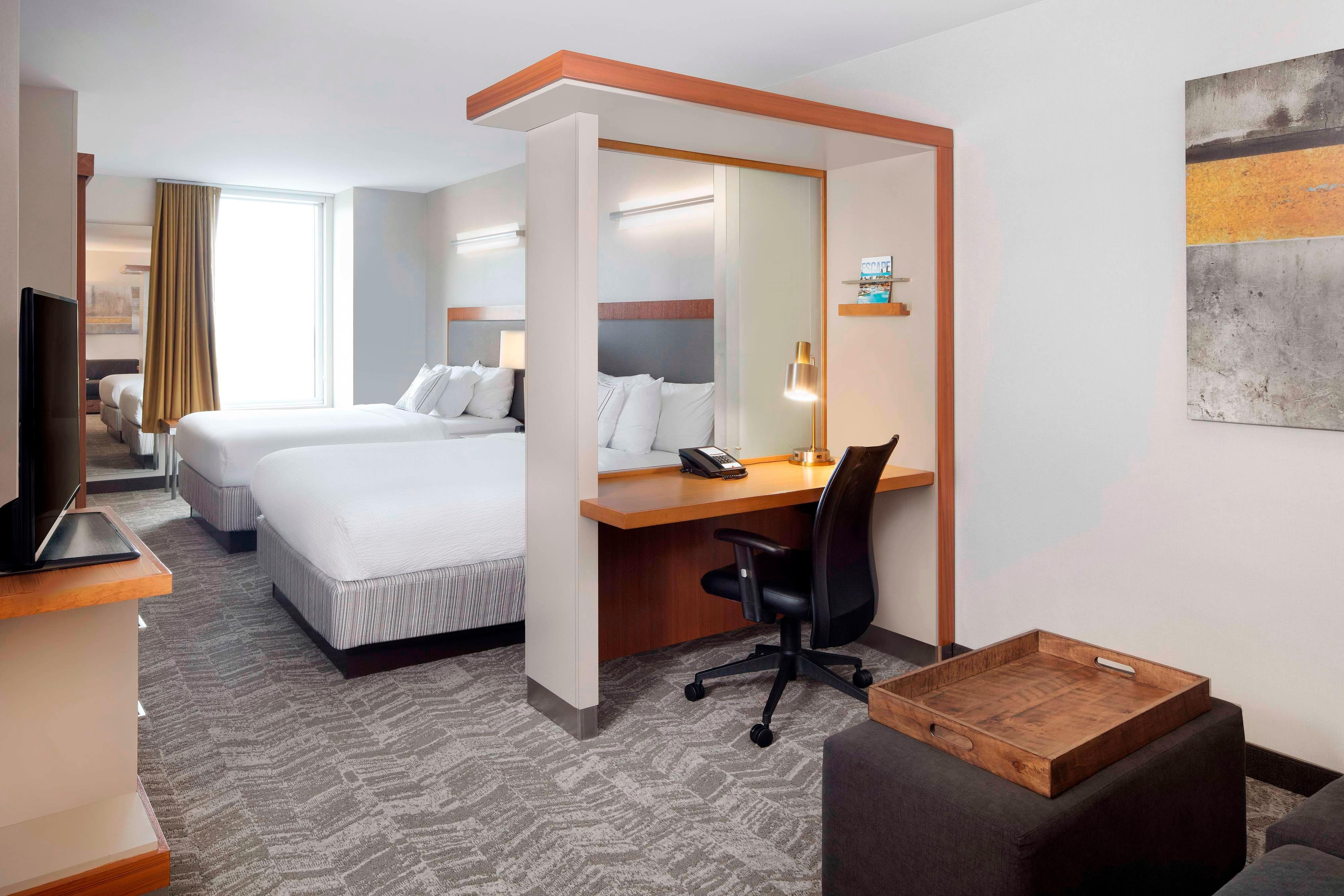 Suite mit zwei Queensize-Betten im oberen Etagenbereich