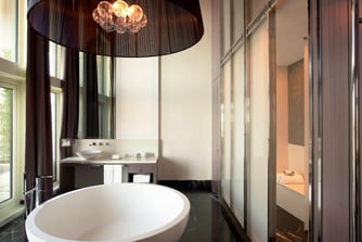 Separate bathtub, hammam and sauna in the large bathroom of Presidential Suite