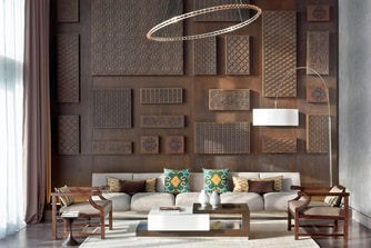 Presidential Suite living room area, with sofas, modern chic design and iconic wall decoration