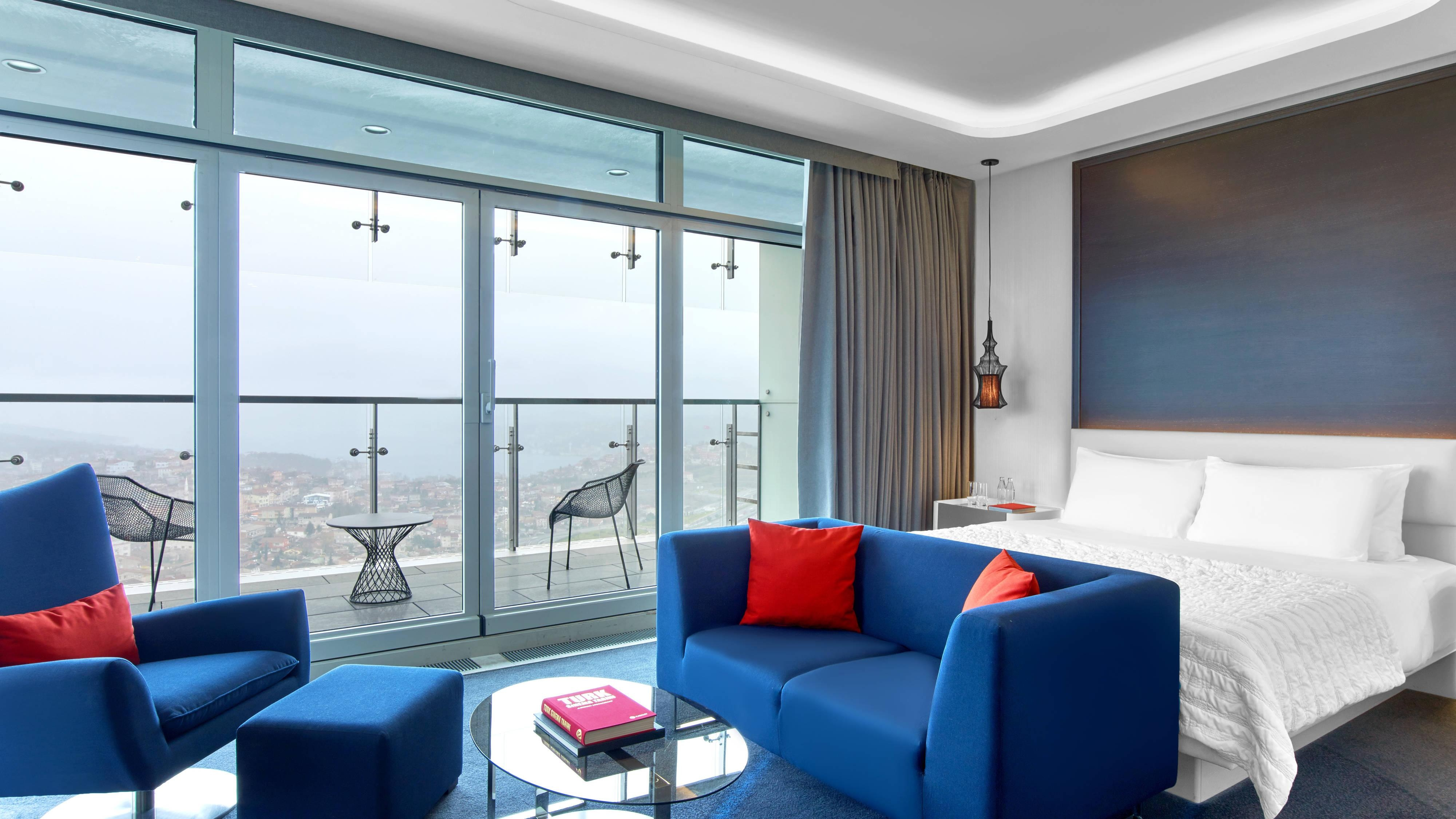 Executive Suite and Junior Suite with king size bed, seating area and private terrace