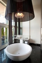 Separate bathtub in the large bathroom of Presidential Suite