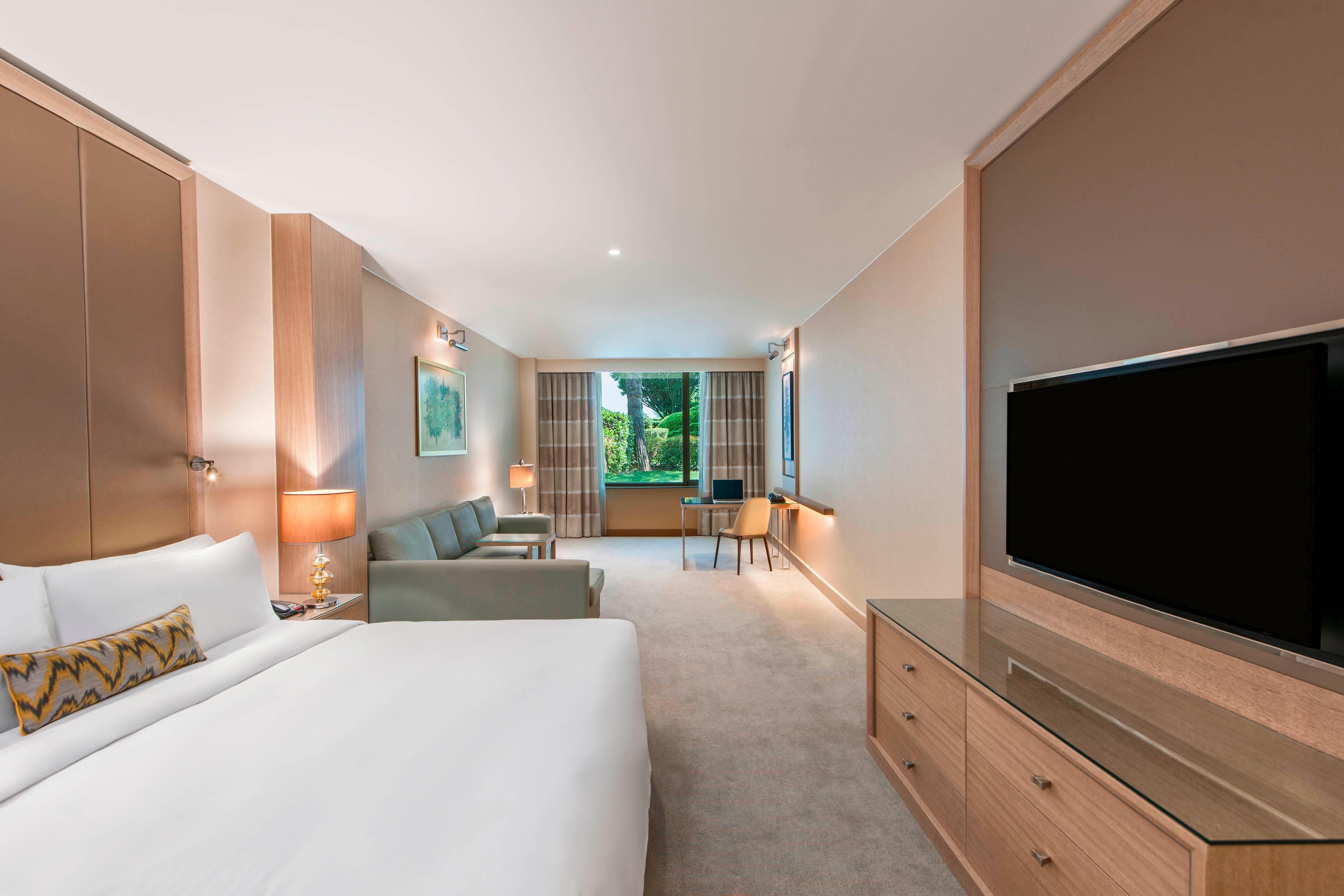 Chambre Deluxe avec lit king size et vue sur le jardin