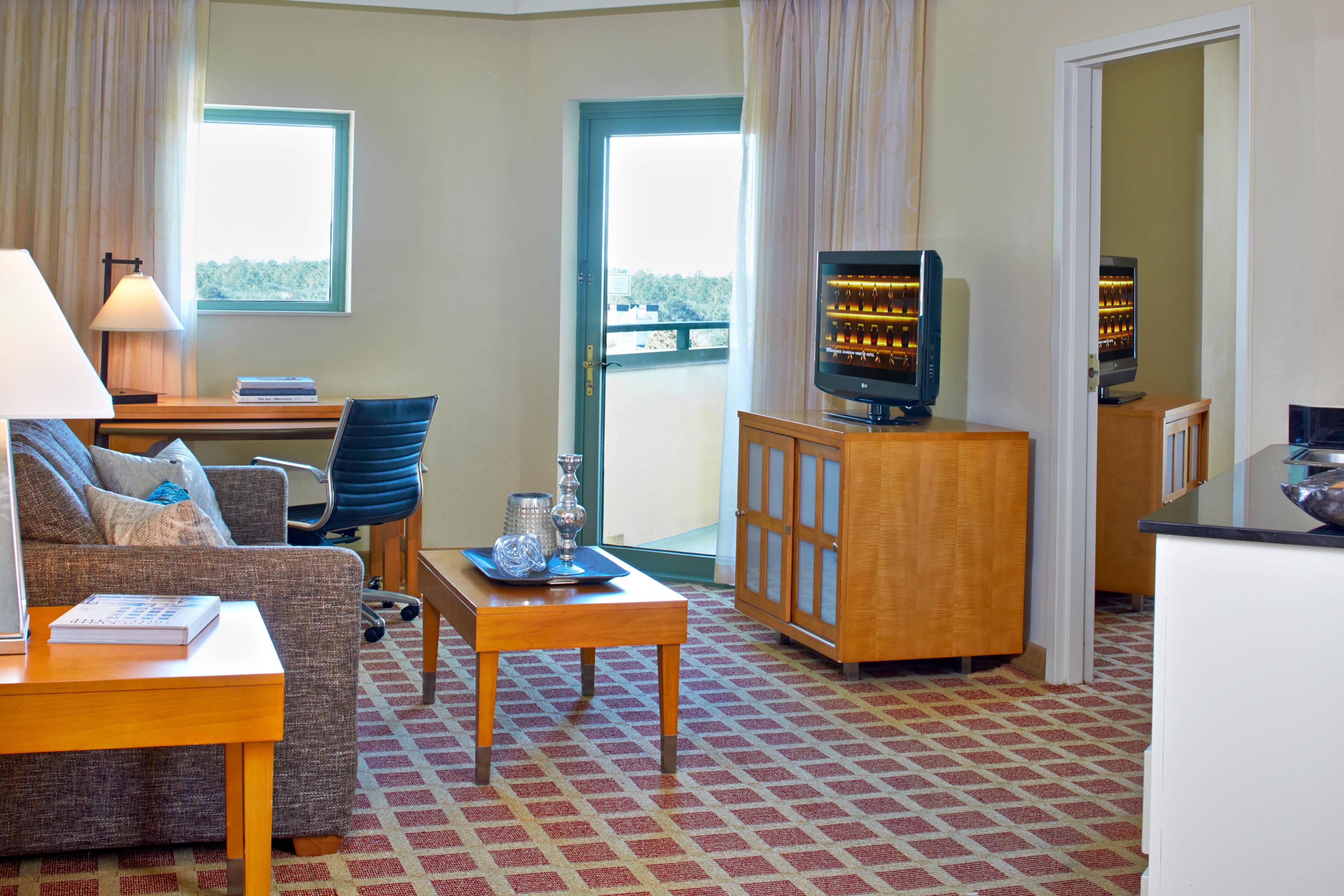 Salle de séjour d'une suite à une chambre