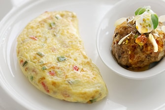 Signature Breakfast vegeTable omelet with kashta masoub