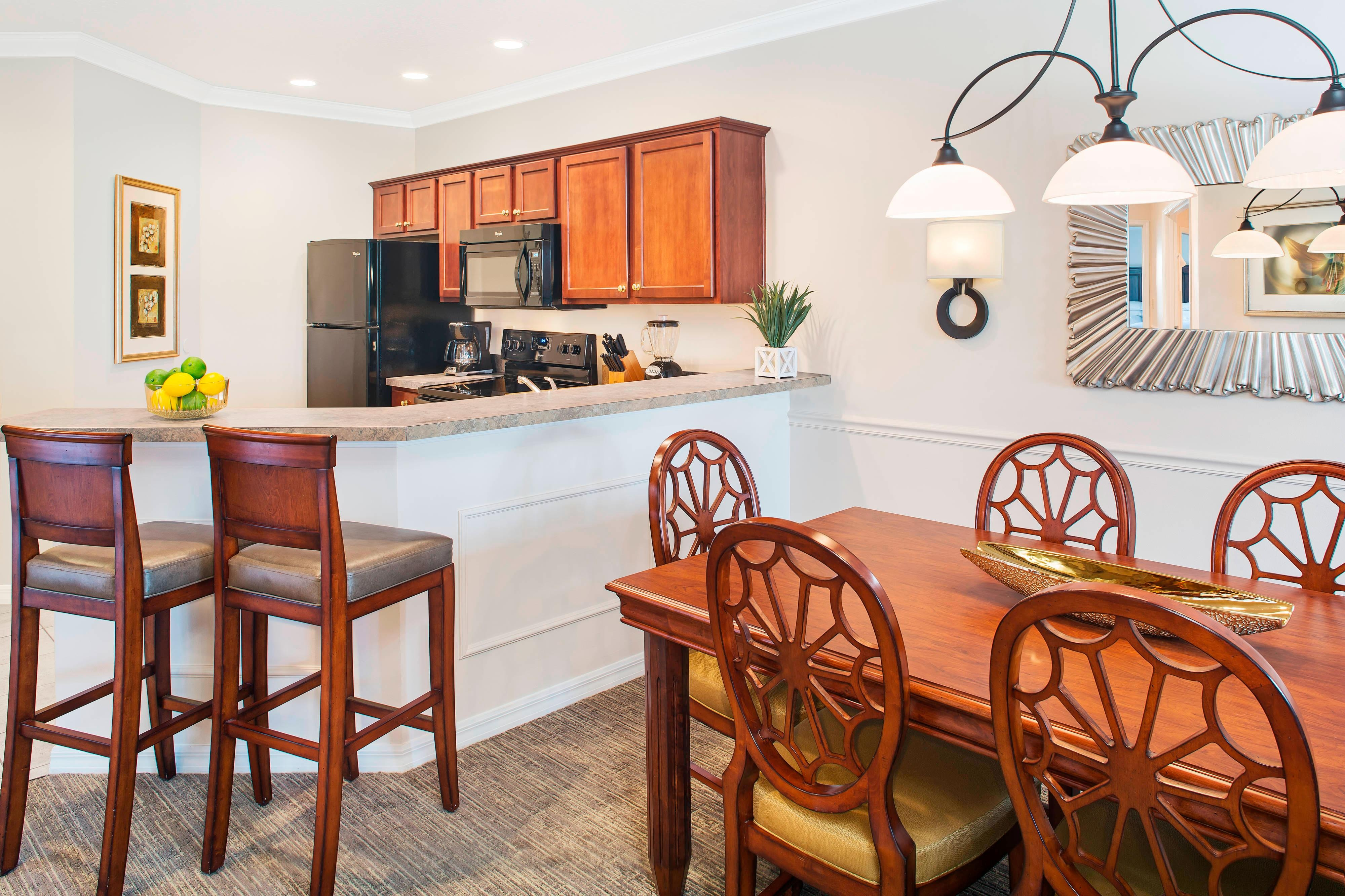 One-Bedroom Premium Villa Dining Kitchen Furnishings May Vary