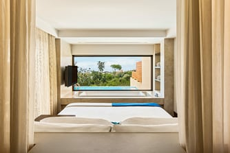 View from the bedroom of the Ionian Grand Infinity Suite Garden View