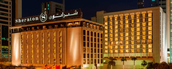 Exterior of the Sheraton Kuwait, A Luxury Collection Hotel at night
