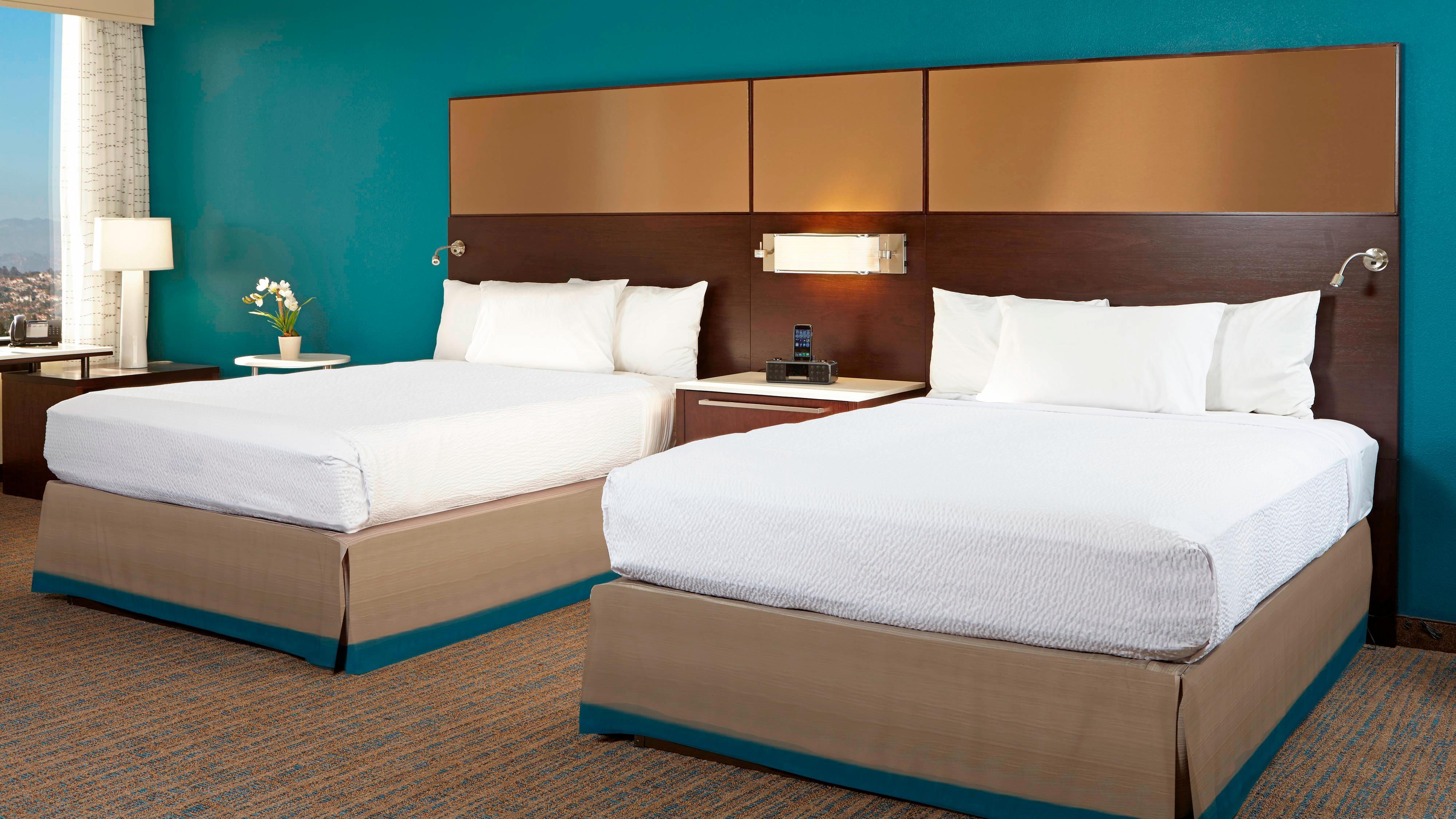 Schlafbereich der Studio Suite mit zwei Queensize-Betten