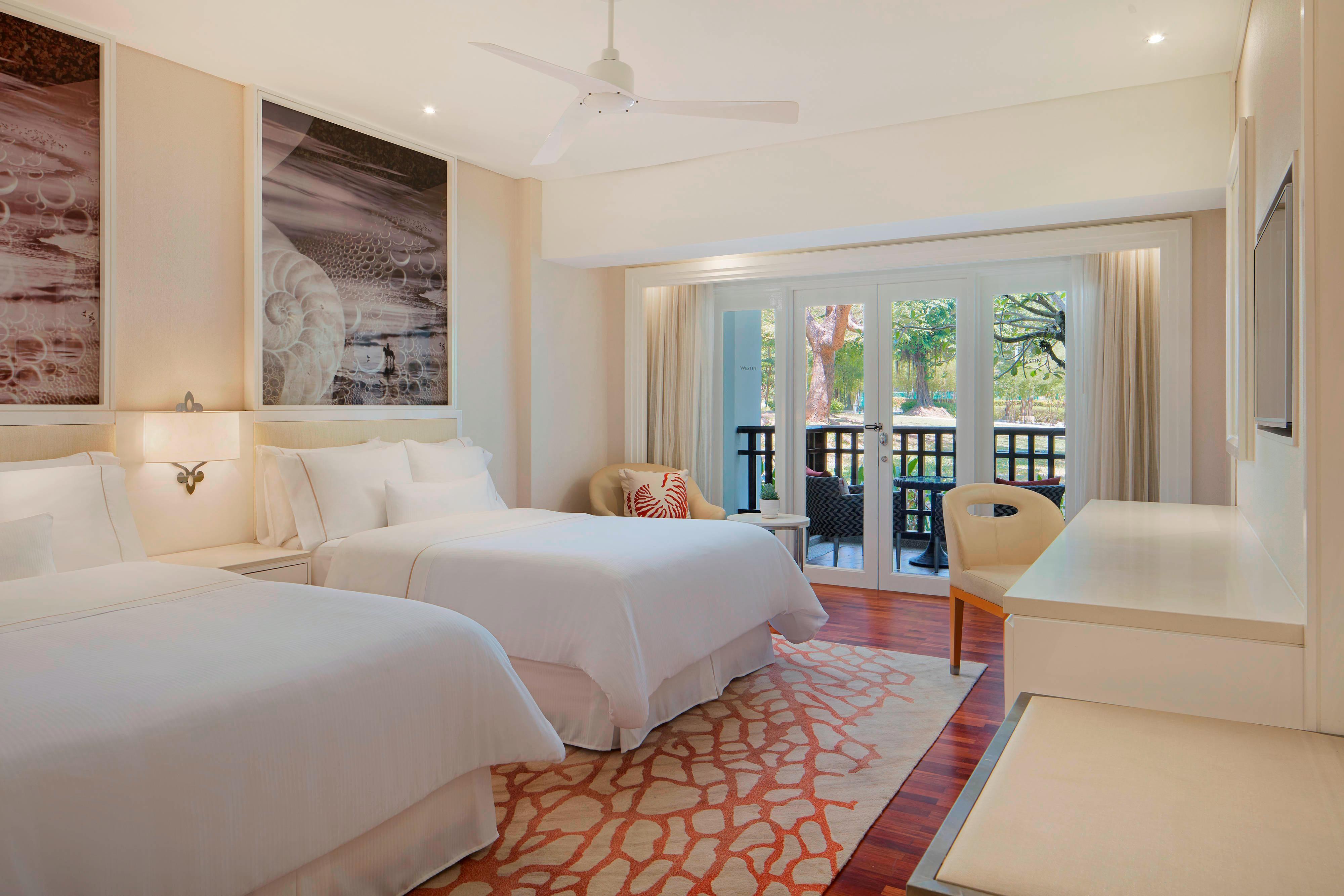 Chambre Premium avec deuxlits queen size et vue sur le jardin