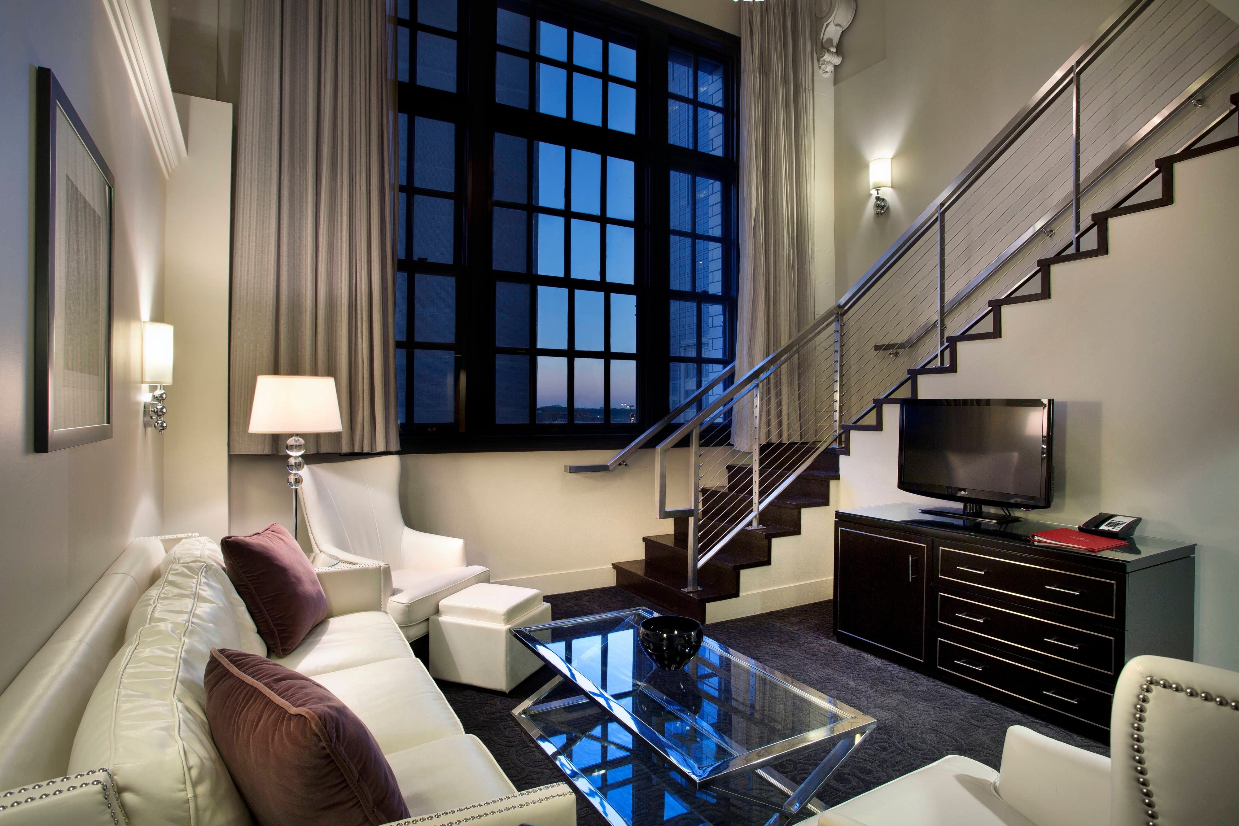 On the first floor of this Bi-Level Loft Suite, you will find ample seating.