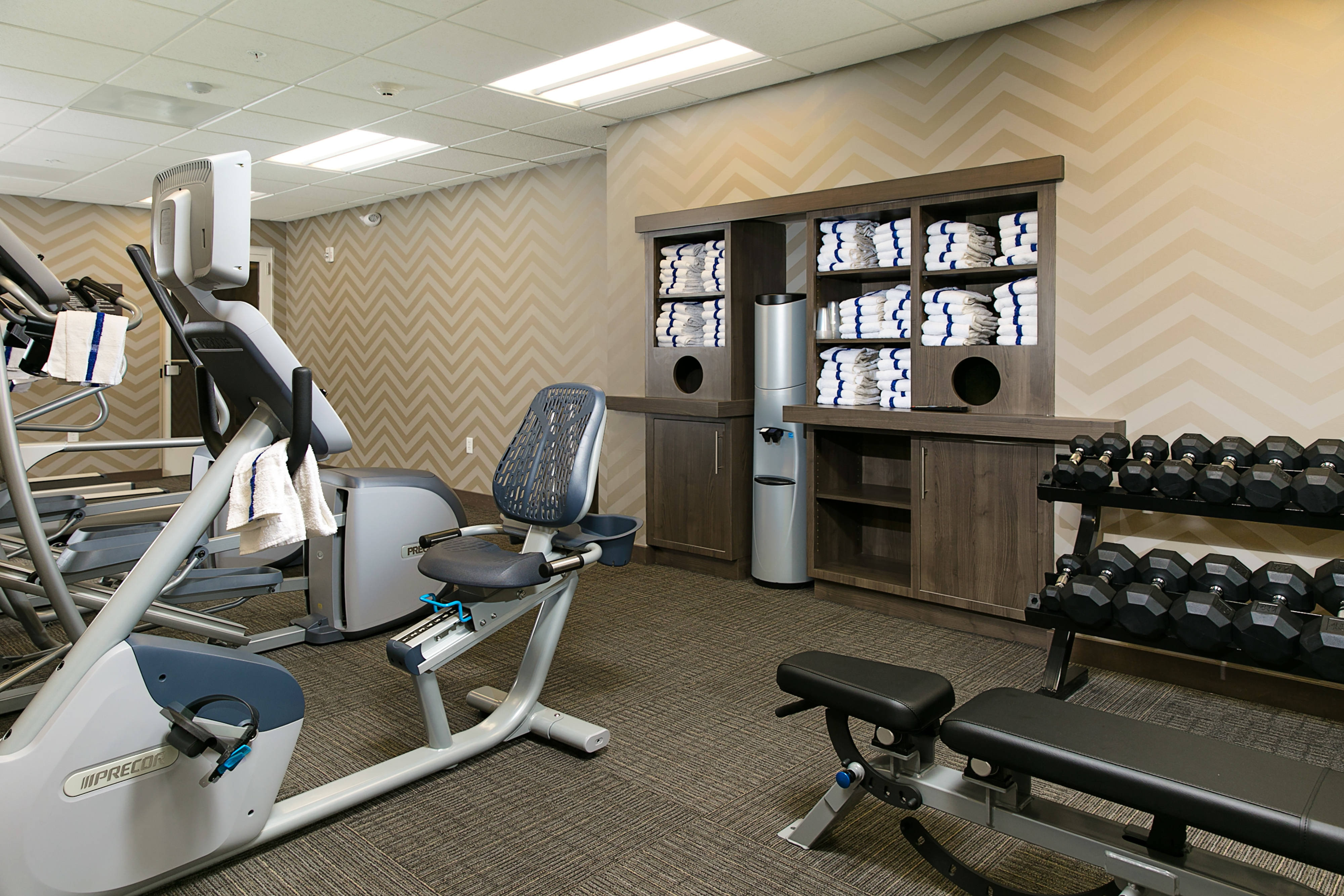 On-site Fitness Center with Weights and Equipment