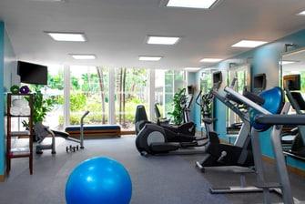 Fitness Room overlooKing Pool and Garden