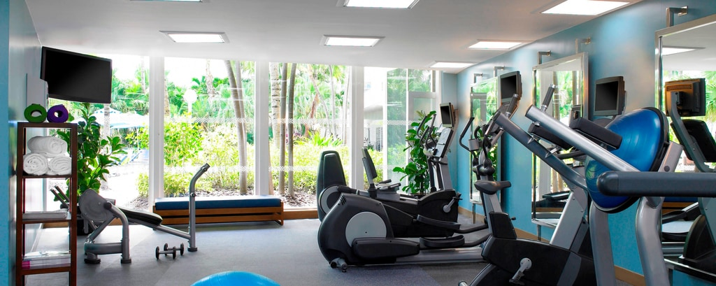 Fitness Room overlooKing Pool and Garden