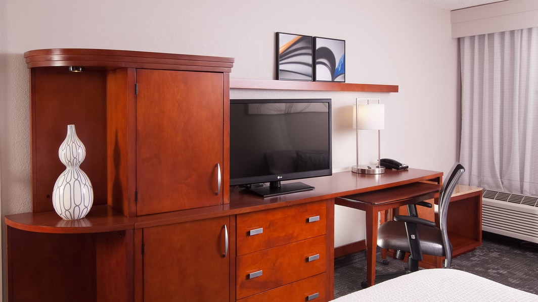 Television and Work Desk area in each room