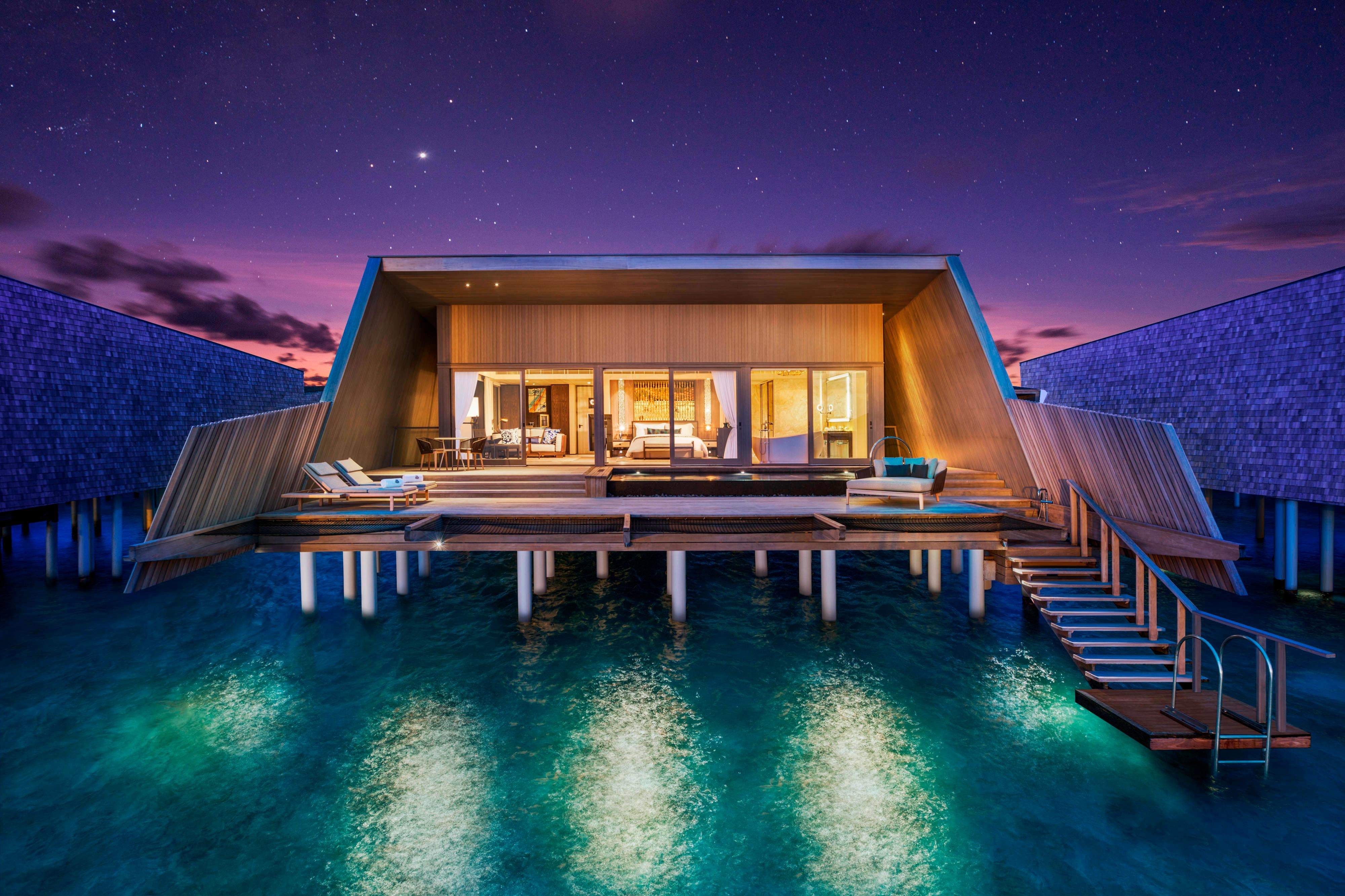 Sunset overwater villa with pool