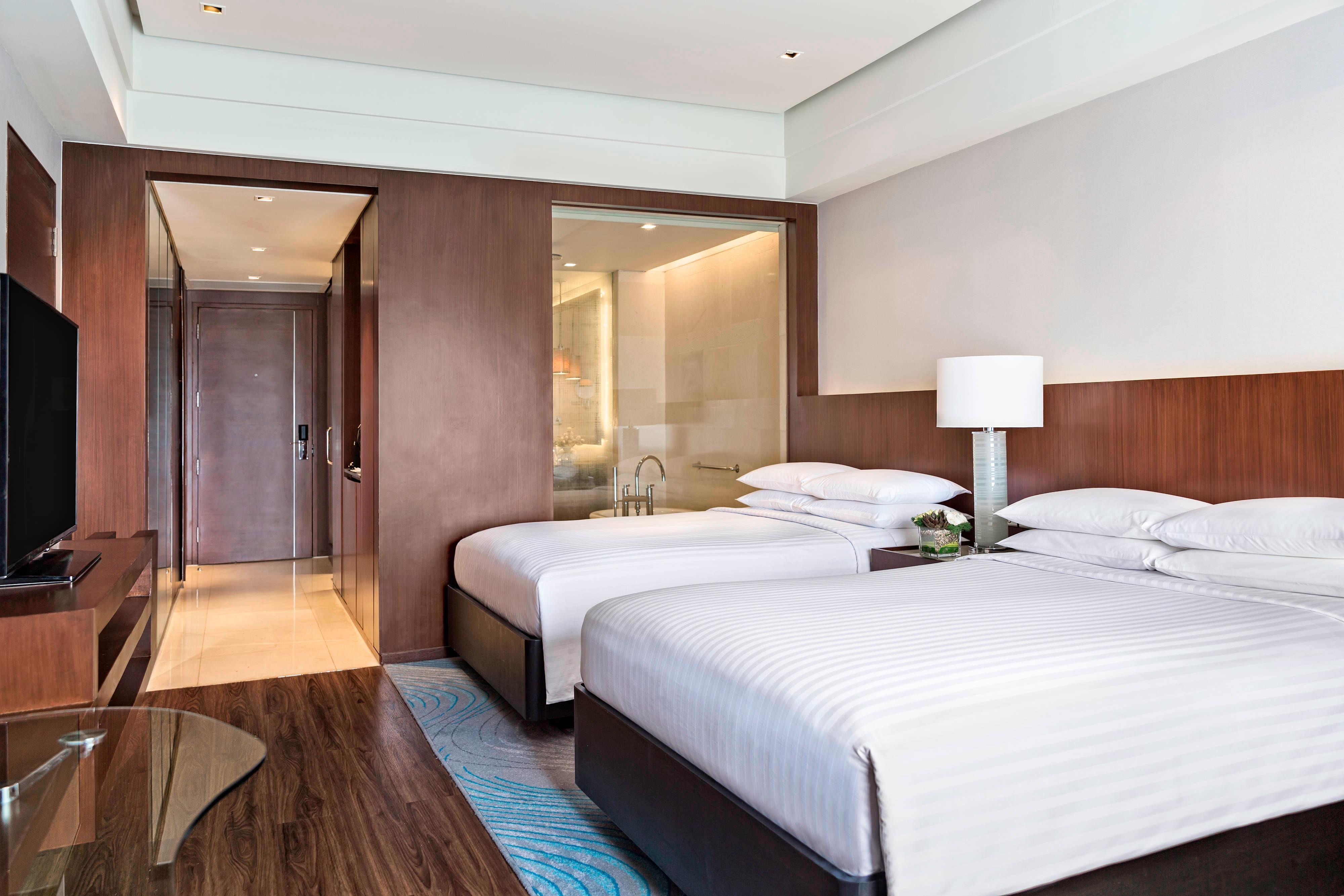 Номер делюкс с двумя двуспальными кроватями (Double)