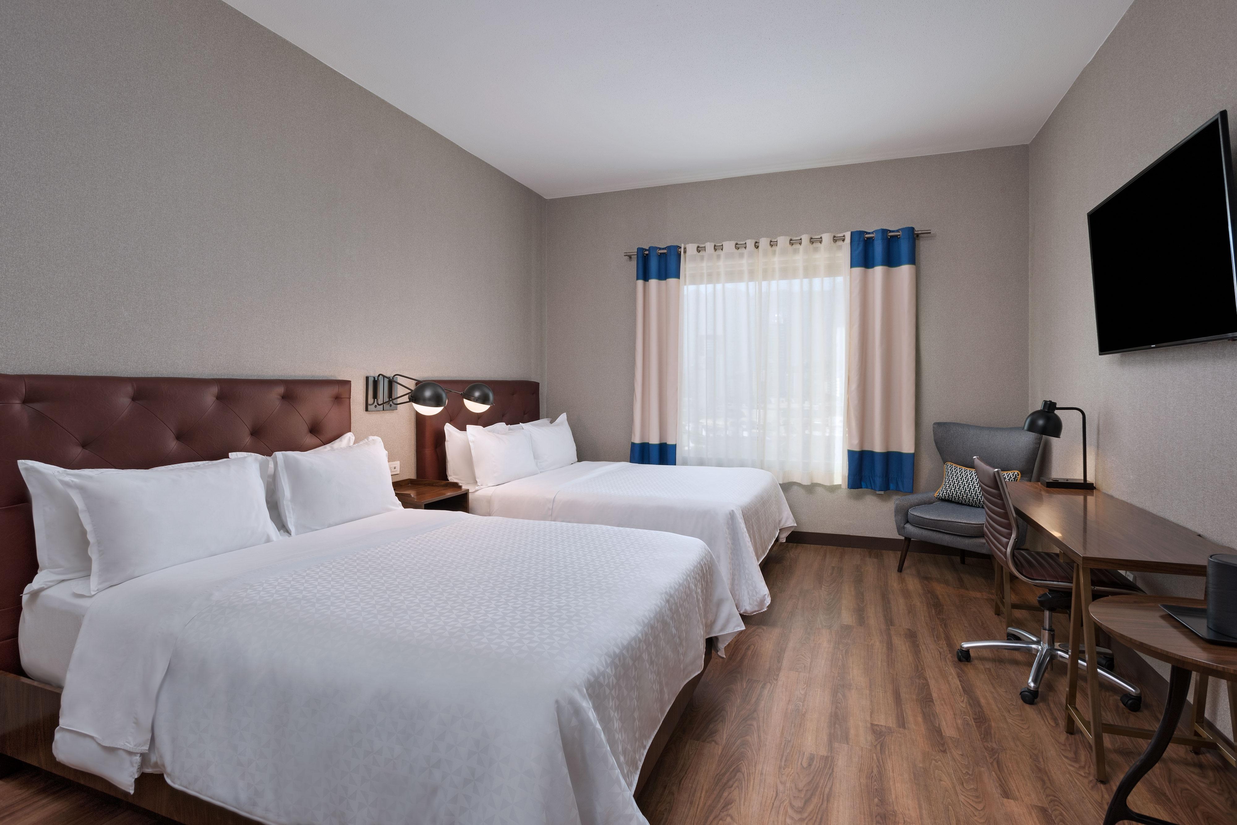 Chambre supérieure avec deux lits queen size
