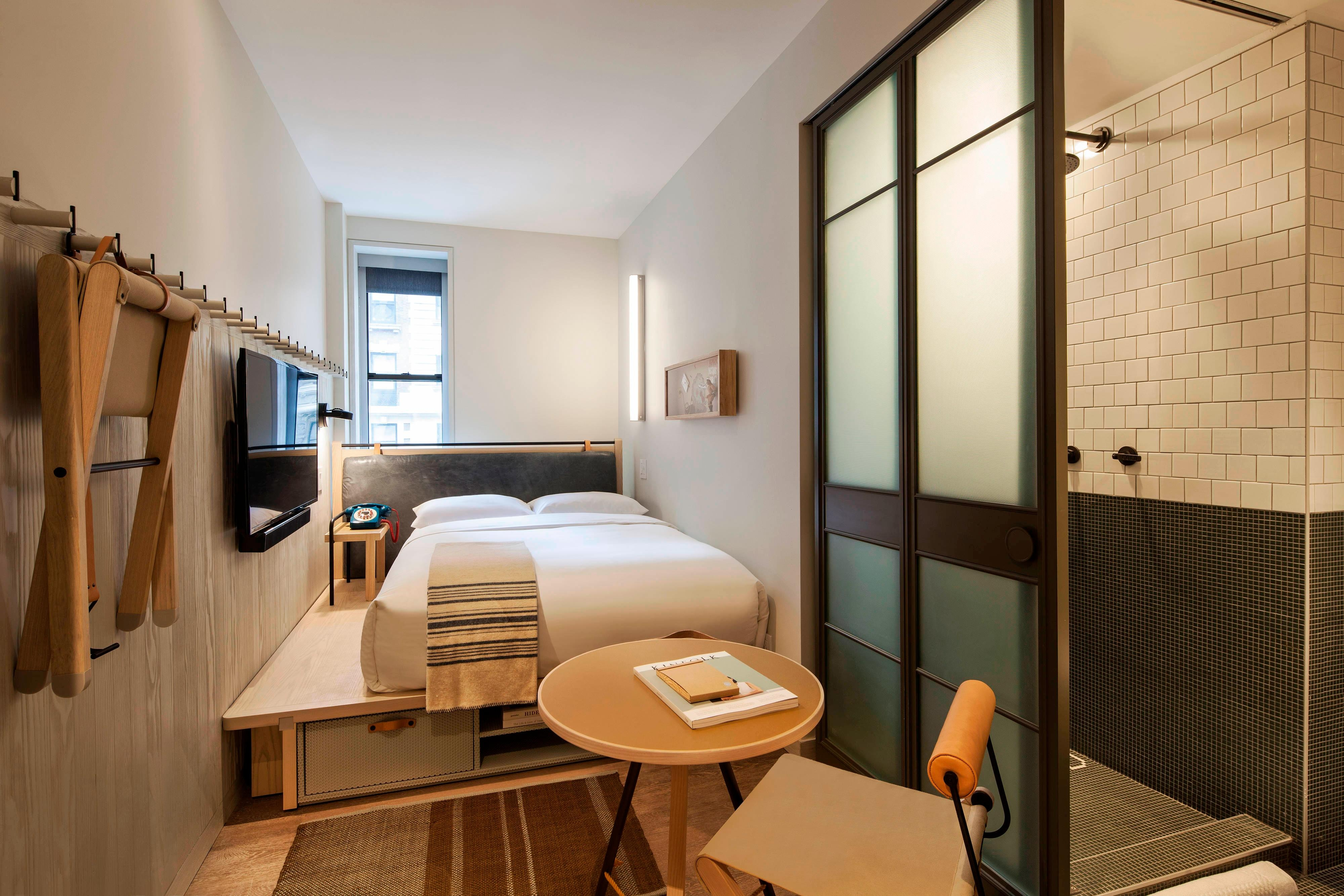 Moxy nyc times square hotel amenities hotel room highlights for Square room interior design review