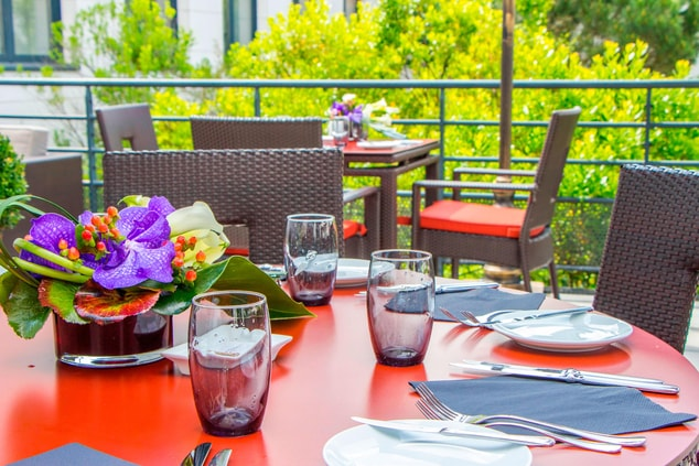 CDG hotel outdoor terrace restaurant