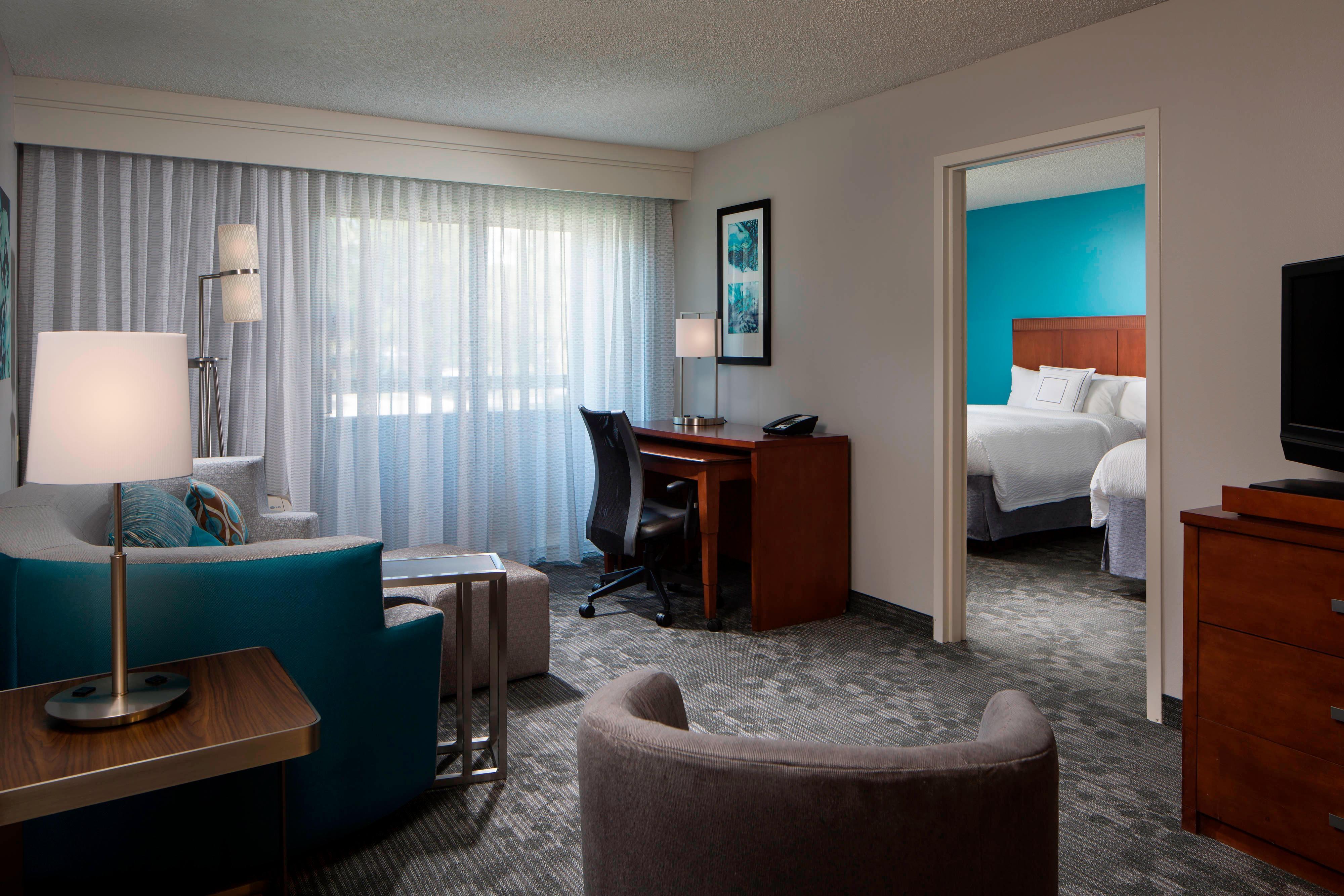 Suite mit zwei Doppelbetten – Wohnbereich