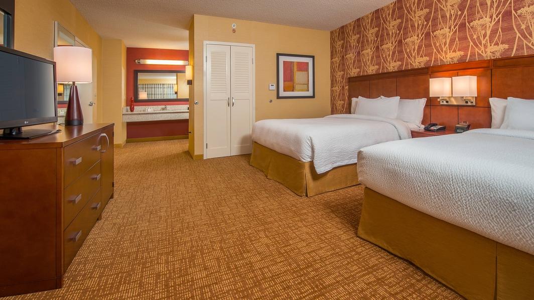 Chambre d'une suite avec deux grands lits