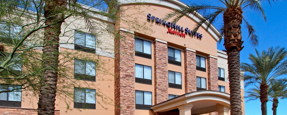 all suite hotel exterior and palm trees