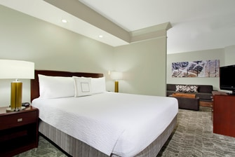 king-sized bed with luxury white bedding