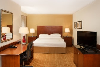 Junior Suite bed, TV & Work Desk