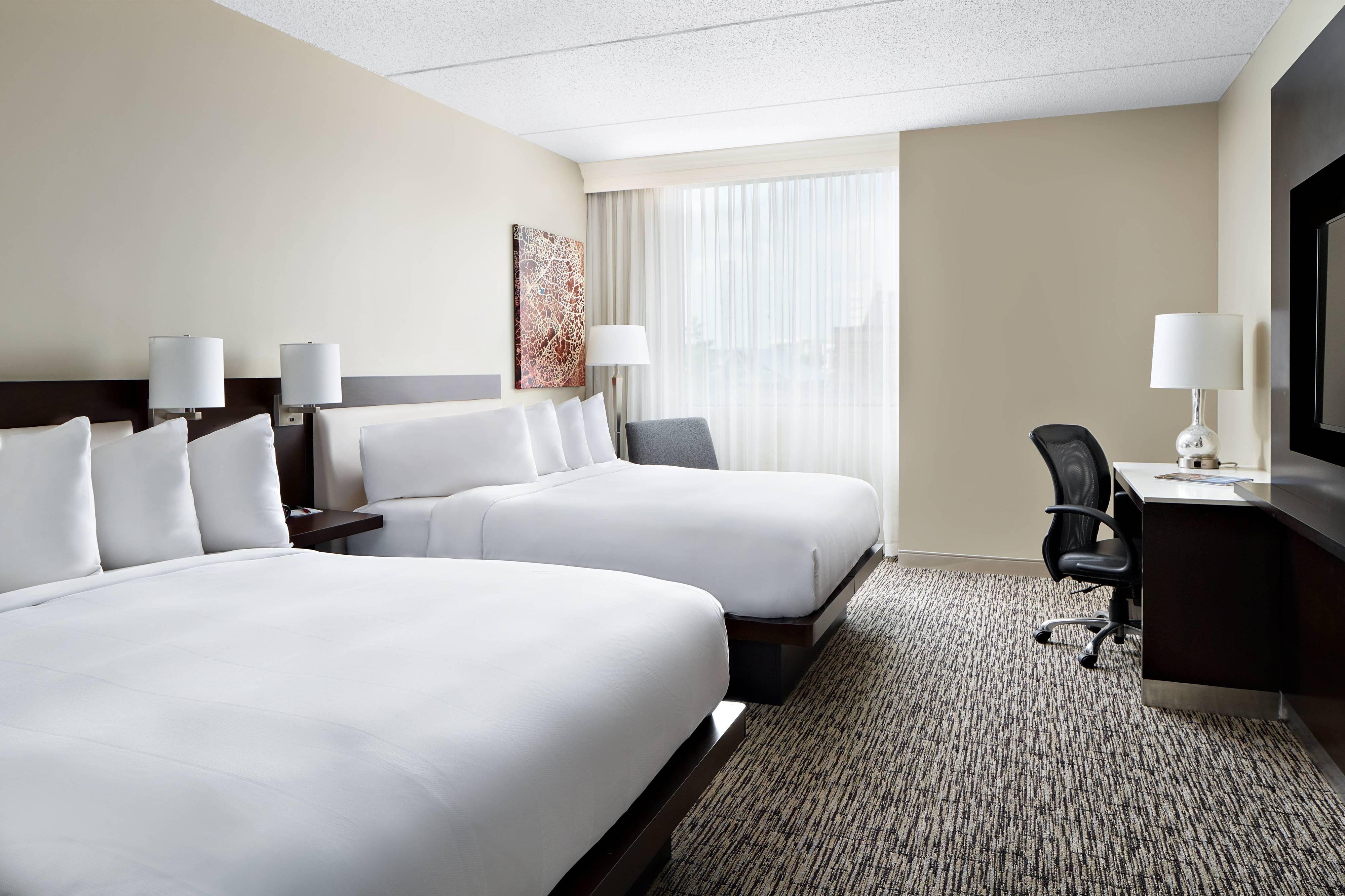 Gästezimmer mit zwei Queensize Betten
