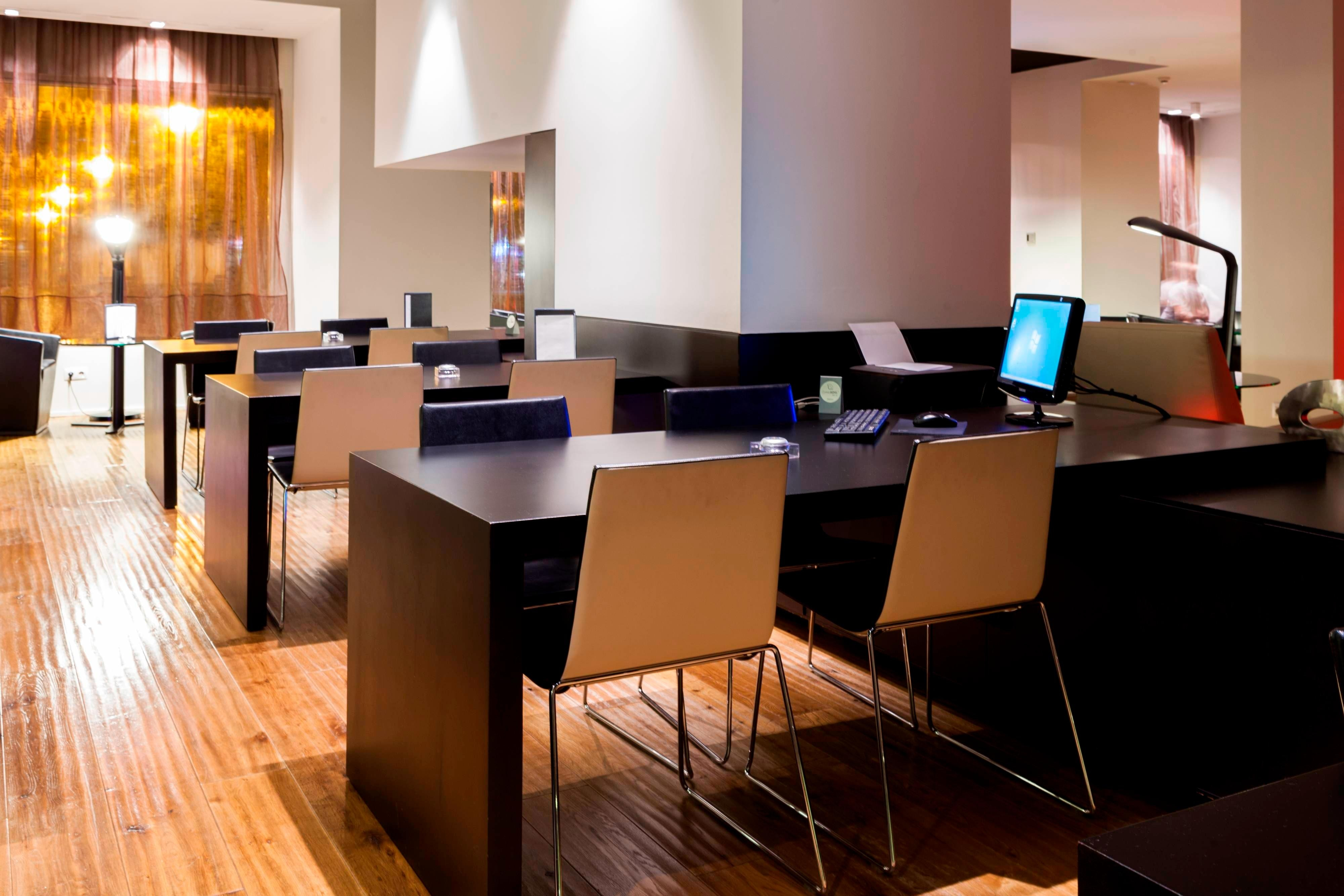 Business corner in AC Ciudad de Pamplona by Marriott