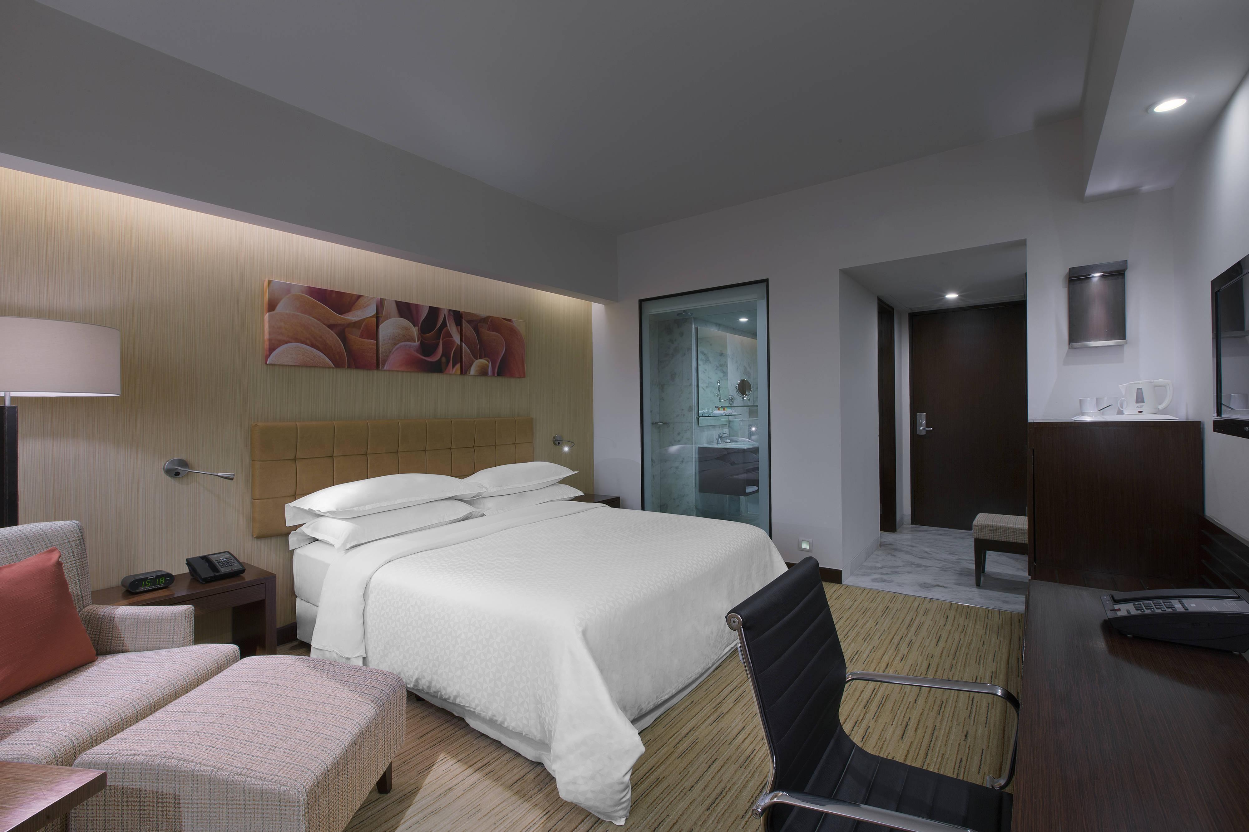 Quarto Comfort 1 com cama king-size