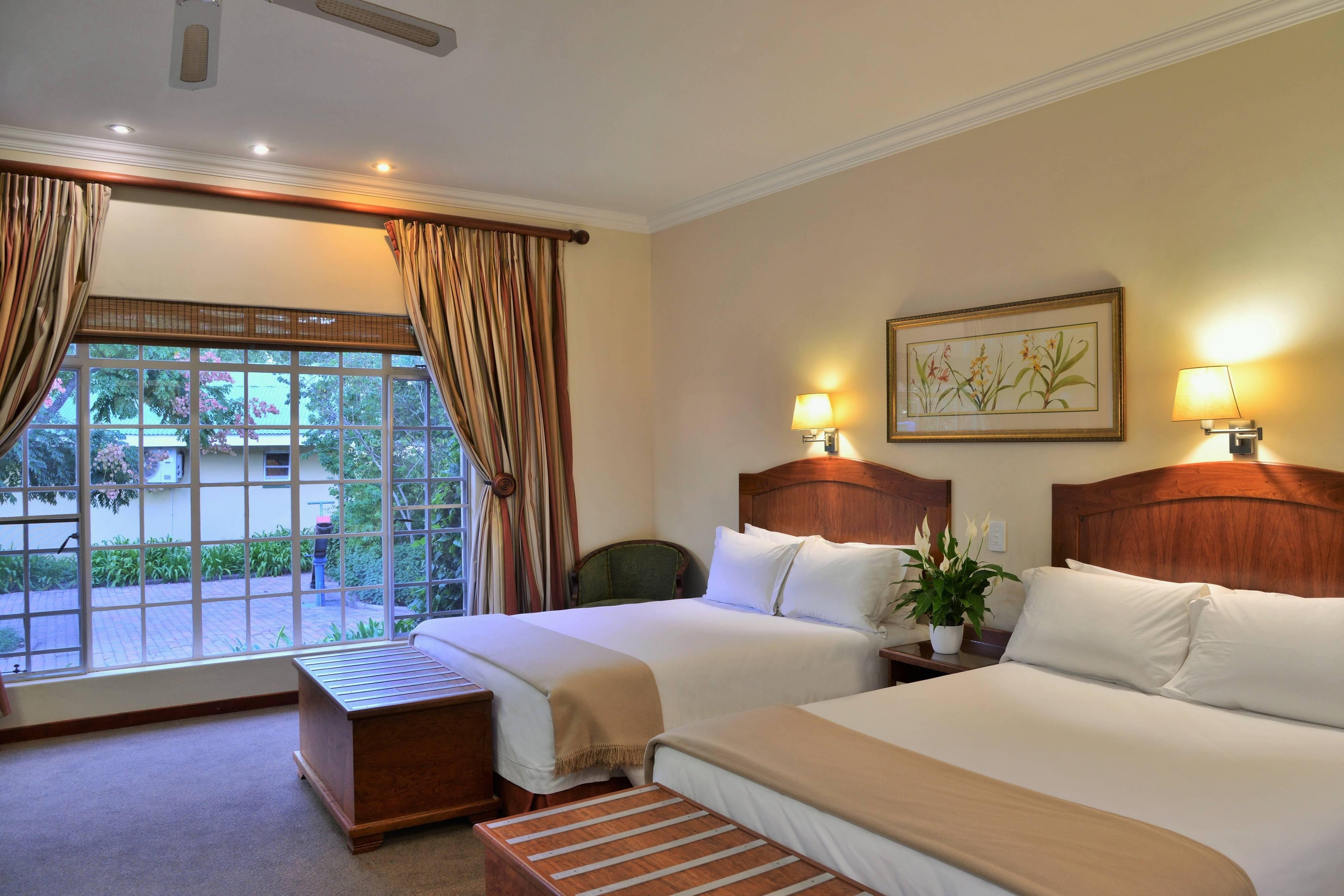 Deluxe-Gästezimmer mit zwei Queensize-Betten
