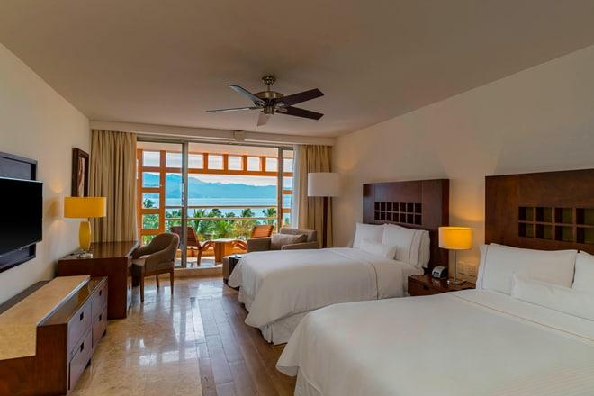 Habitación de lujo, con dos camas dobles, con vista completa al mar