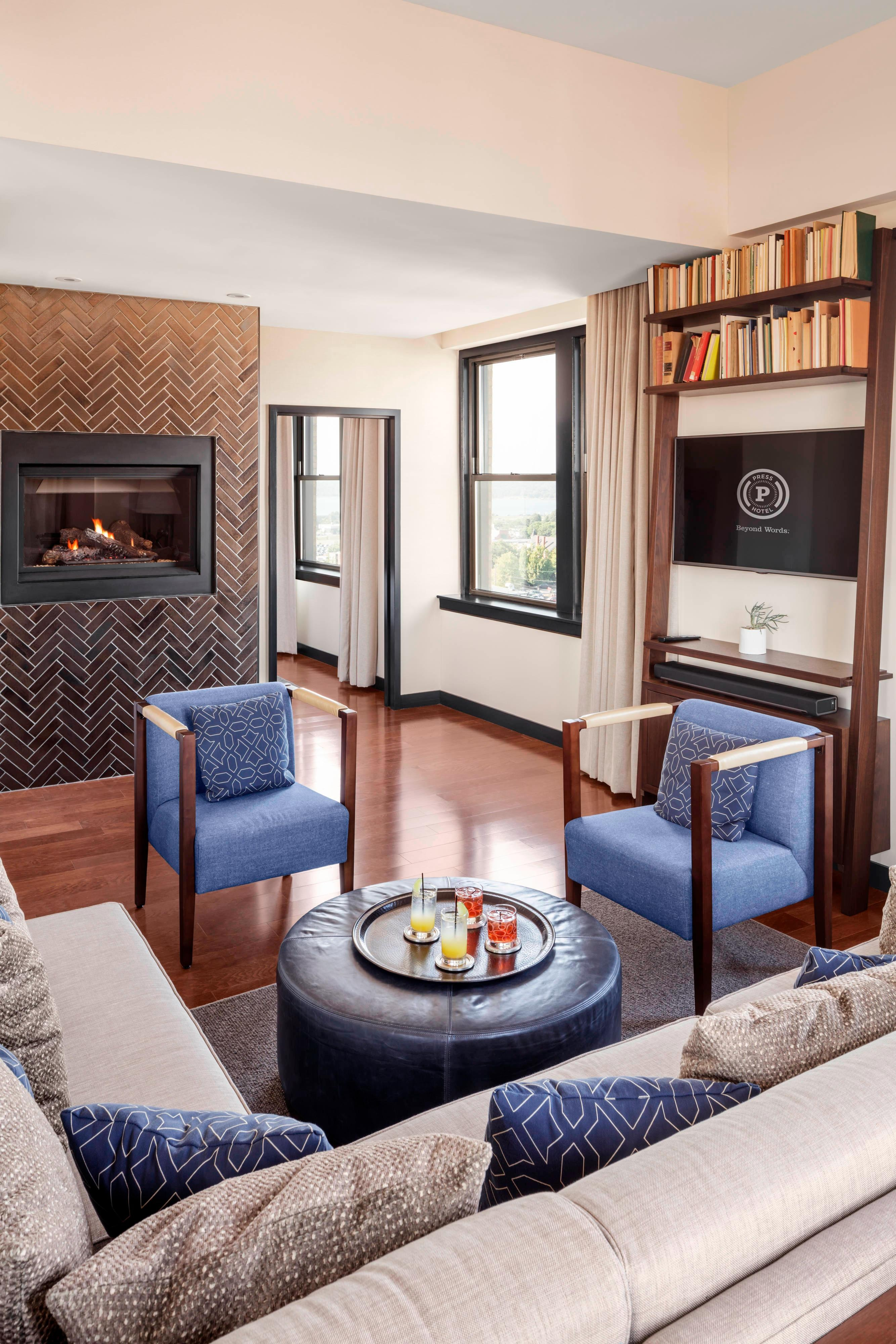 The Living Room of the Penthouse Suite with Fireplace