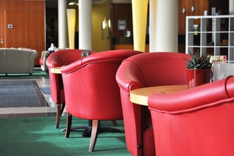 Red chairs at our bistro + bar