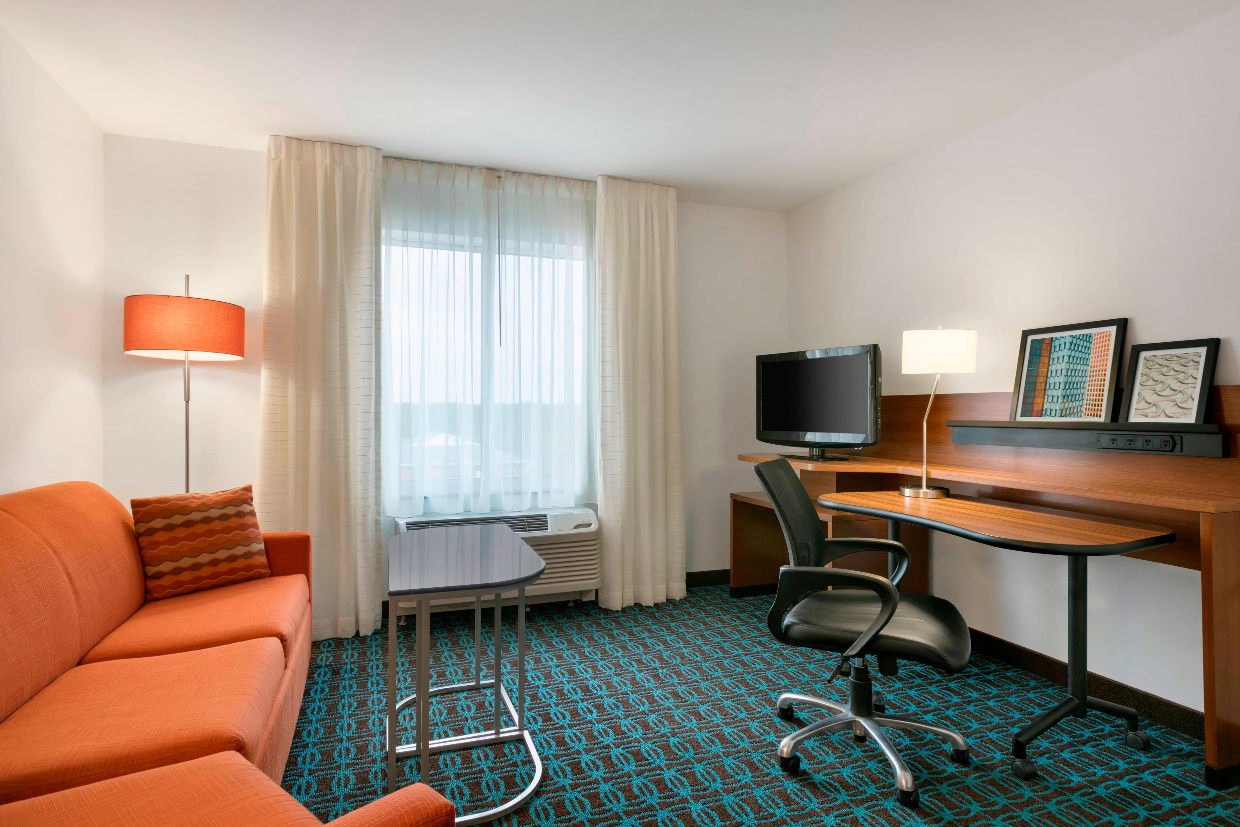 Executive Suite mit zwei Doppelbetten – Wohnbereich