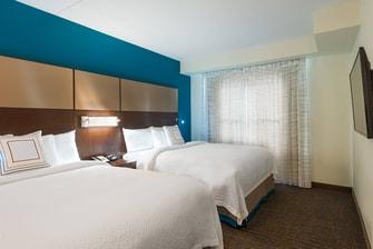 Two-Queen Bedroom Suite Sleeping Area