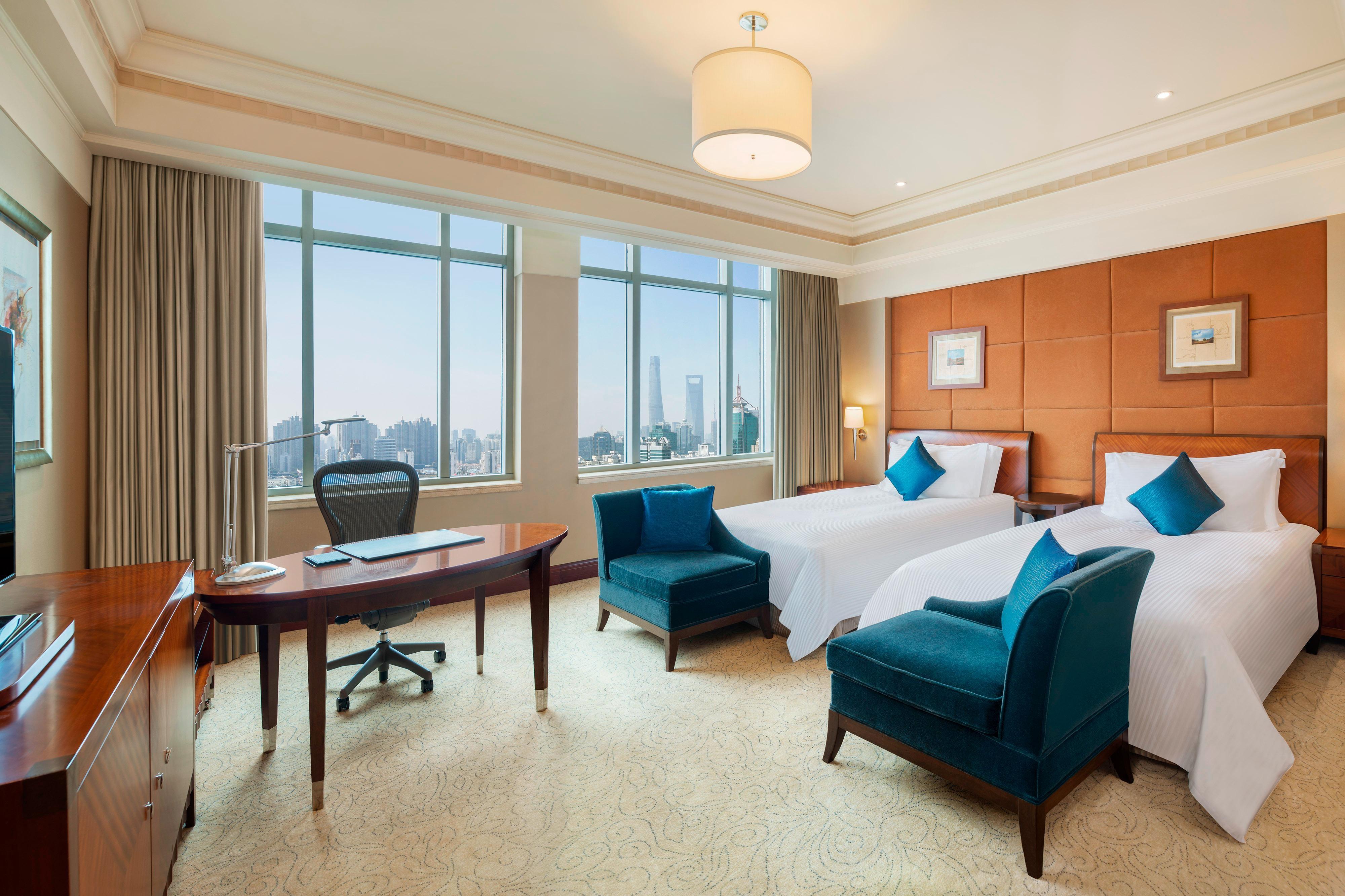 Executive Deluxe Gästezimmer mit zwei Einzelbetten