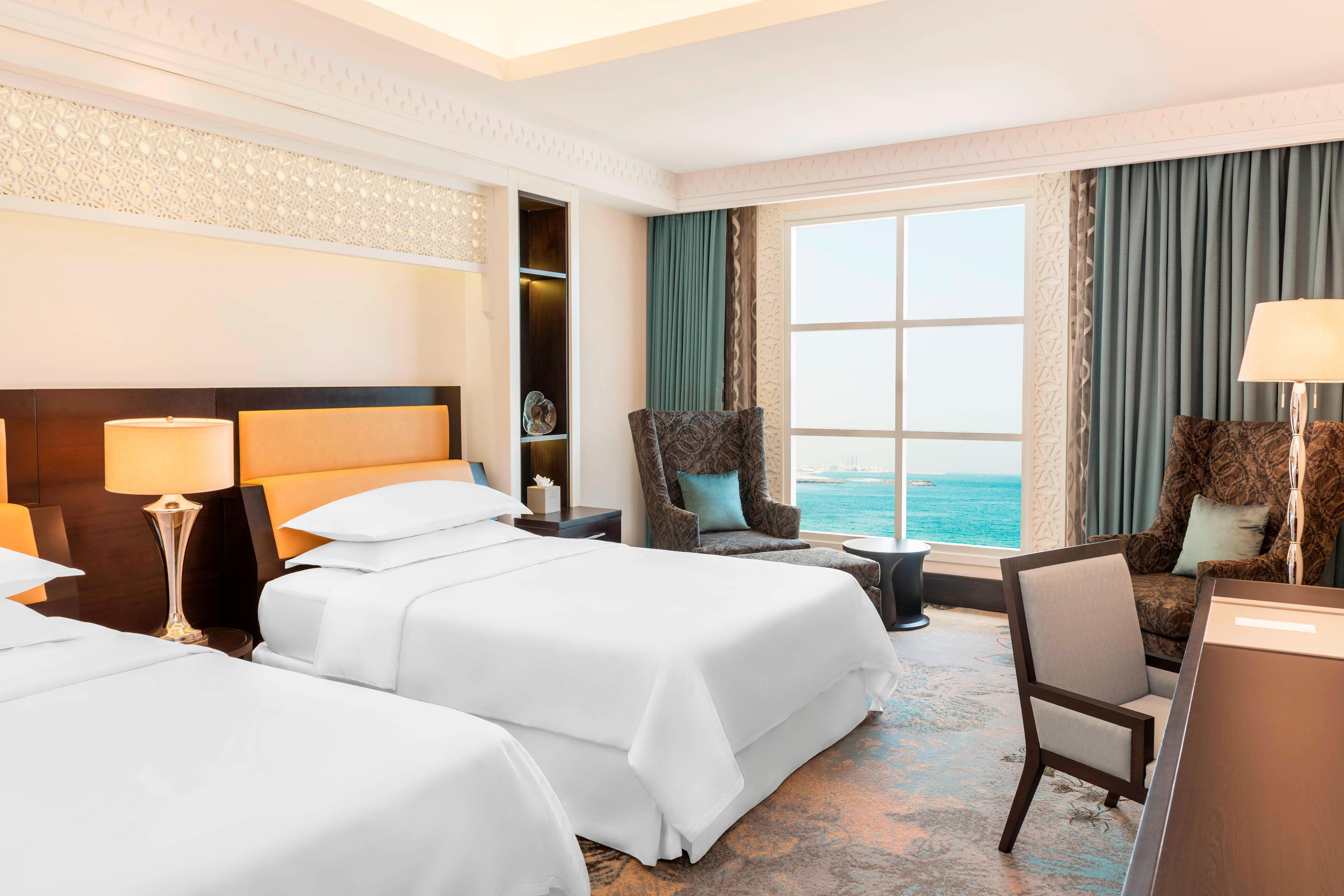 Chambre Deluxe avec lits simples etvue sur la mer